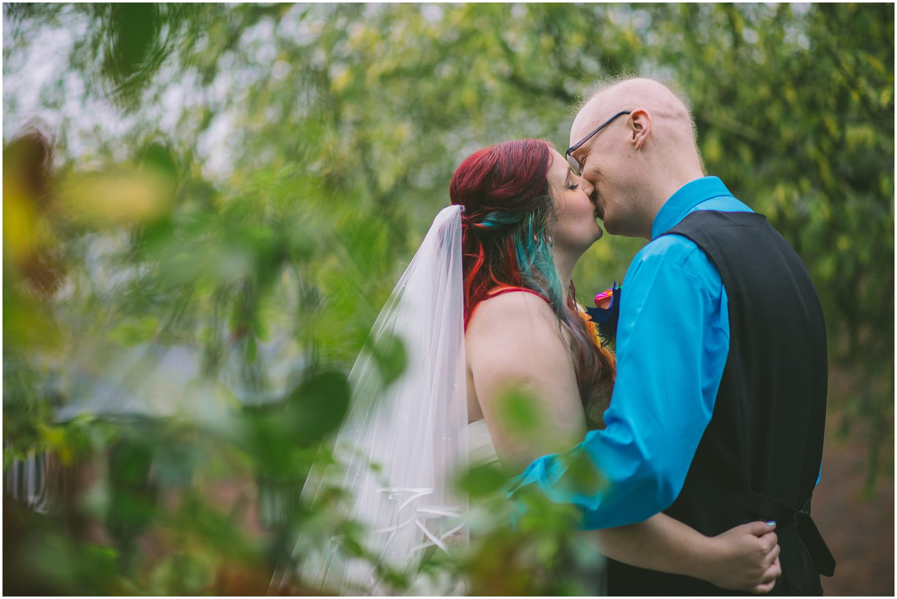 Couple share a kiss at heskin hall