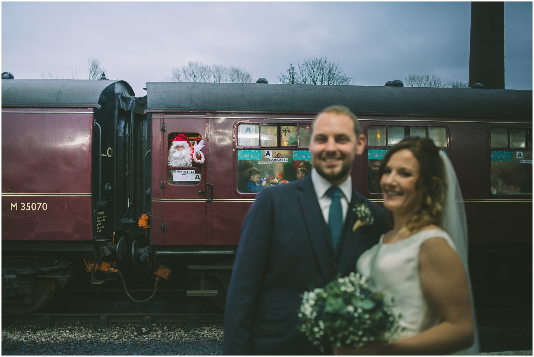Santa photobombs couple at Ramsbottom train station