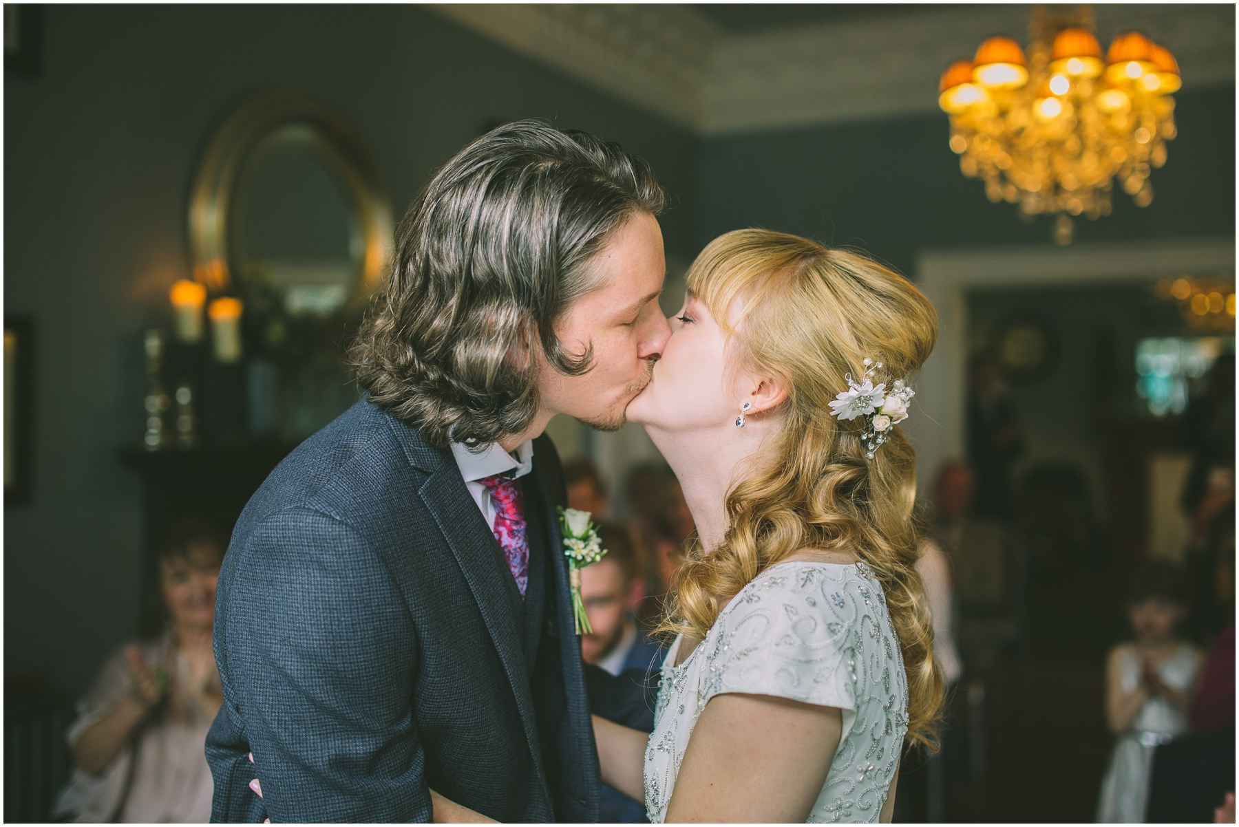 Bride and Grooms first kiss in the blue room at didsbury house hotel
