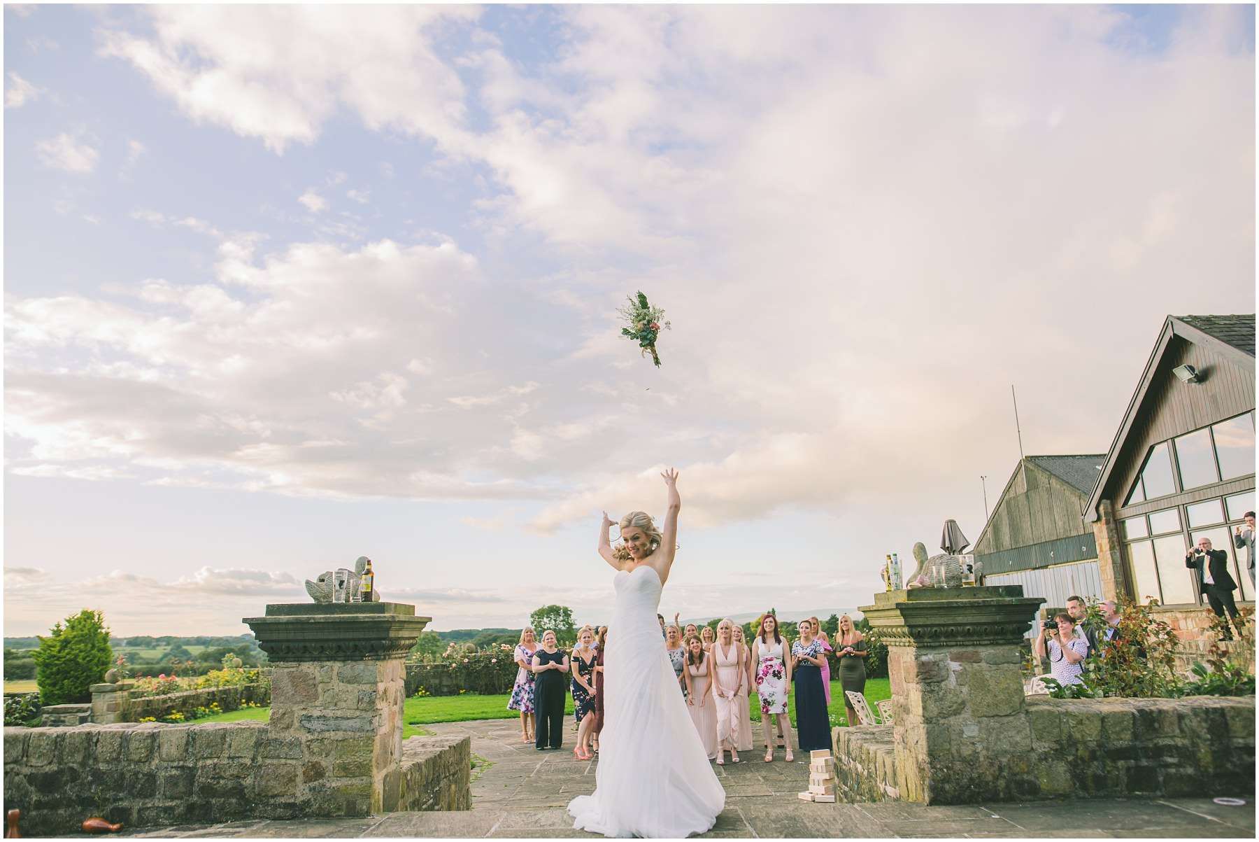 Bride throws her bouquet at Beeston Manor