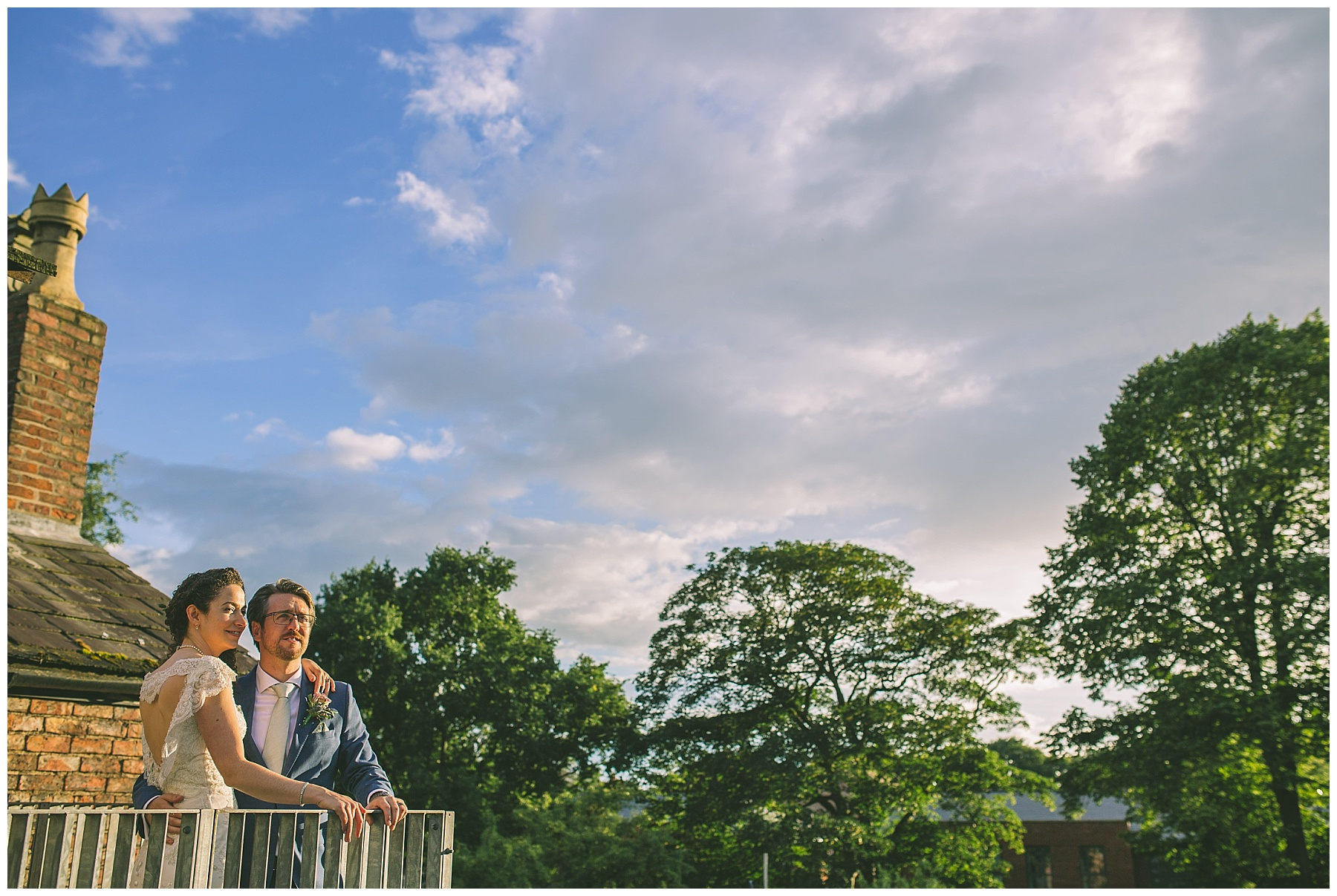 Married couple take in the sunset from the roof of Eleven Didsbury Park