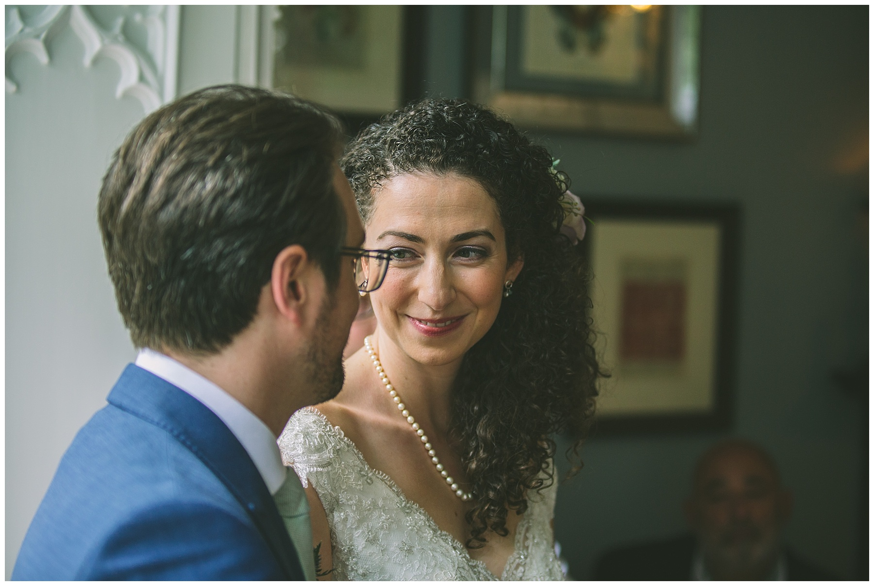 bride and groom exchange a look during the ceremony at Didsbury House