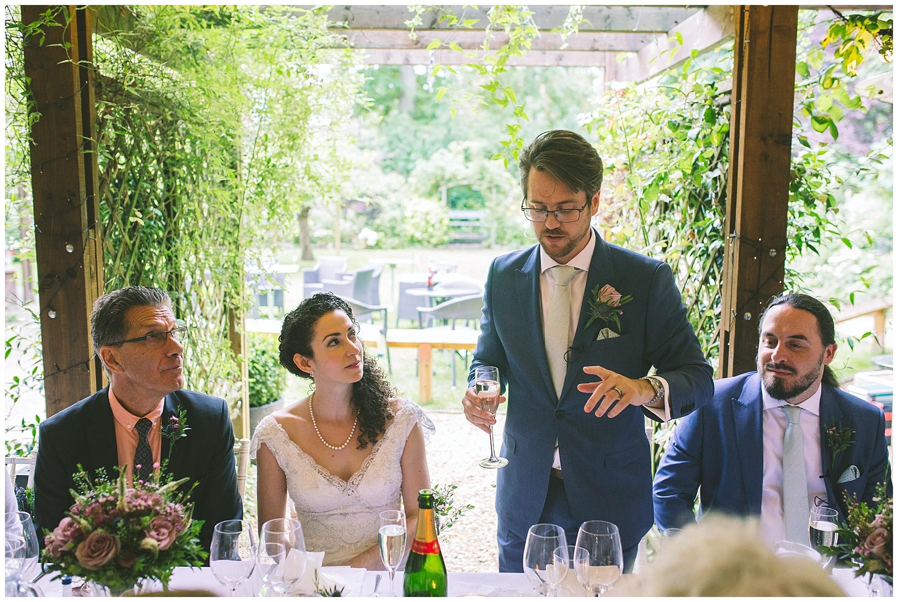 groom prepares a toast