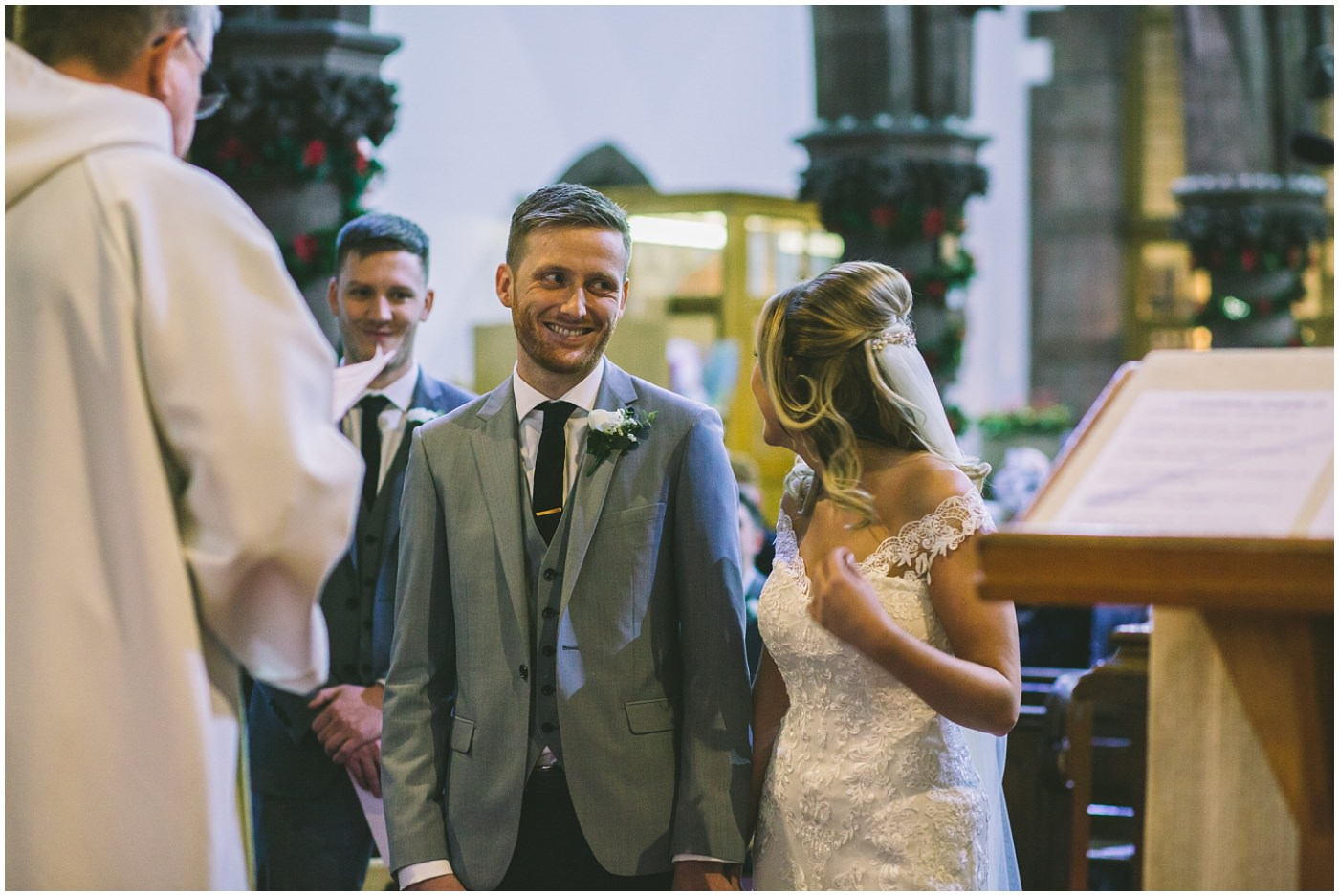 groom smiles as he sees his bride