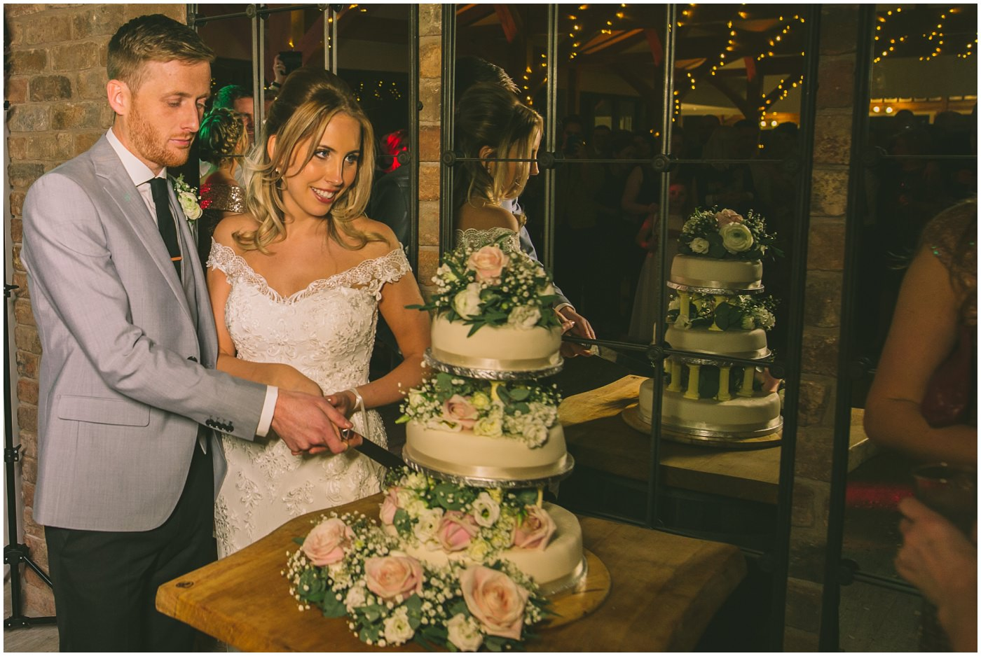 bride and groom cut the cake at Pryors Hayes