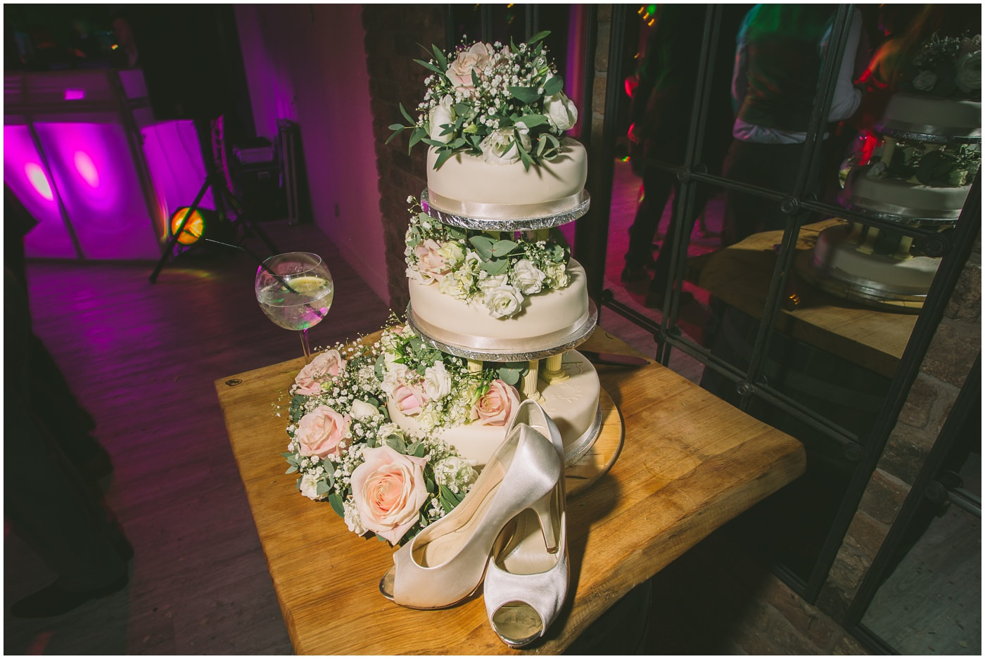 Cake and brides shoes on display at Pryors Hayes
