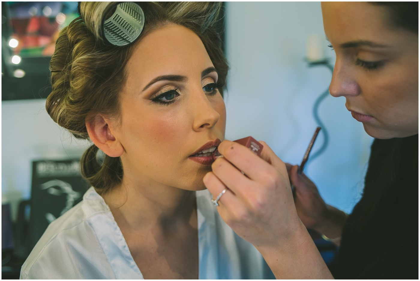 Lipstick being applied for bride