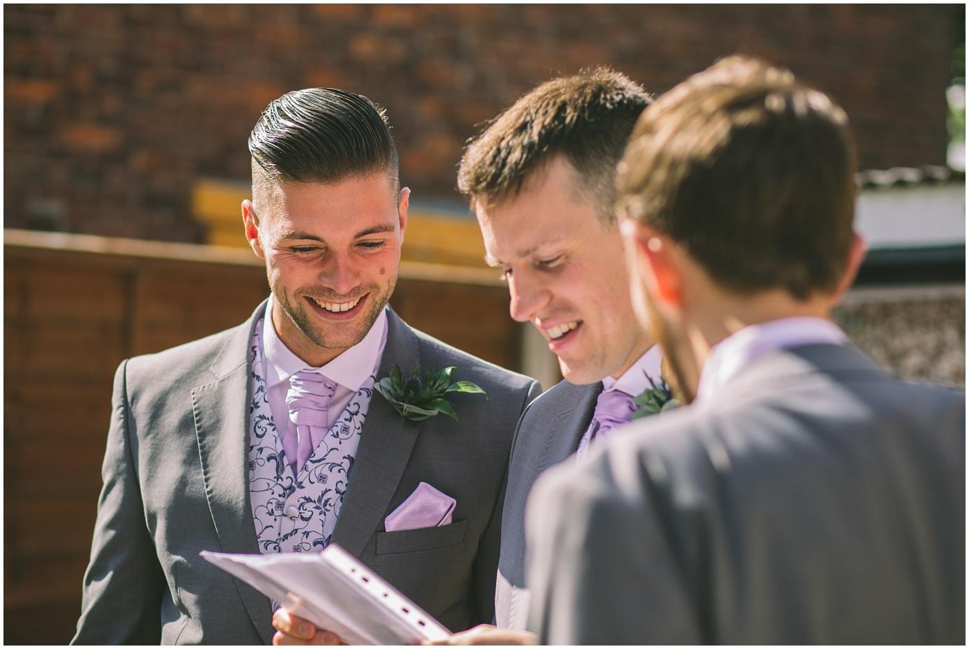 Best man checks his speech before the wedding