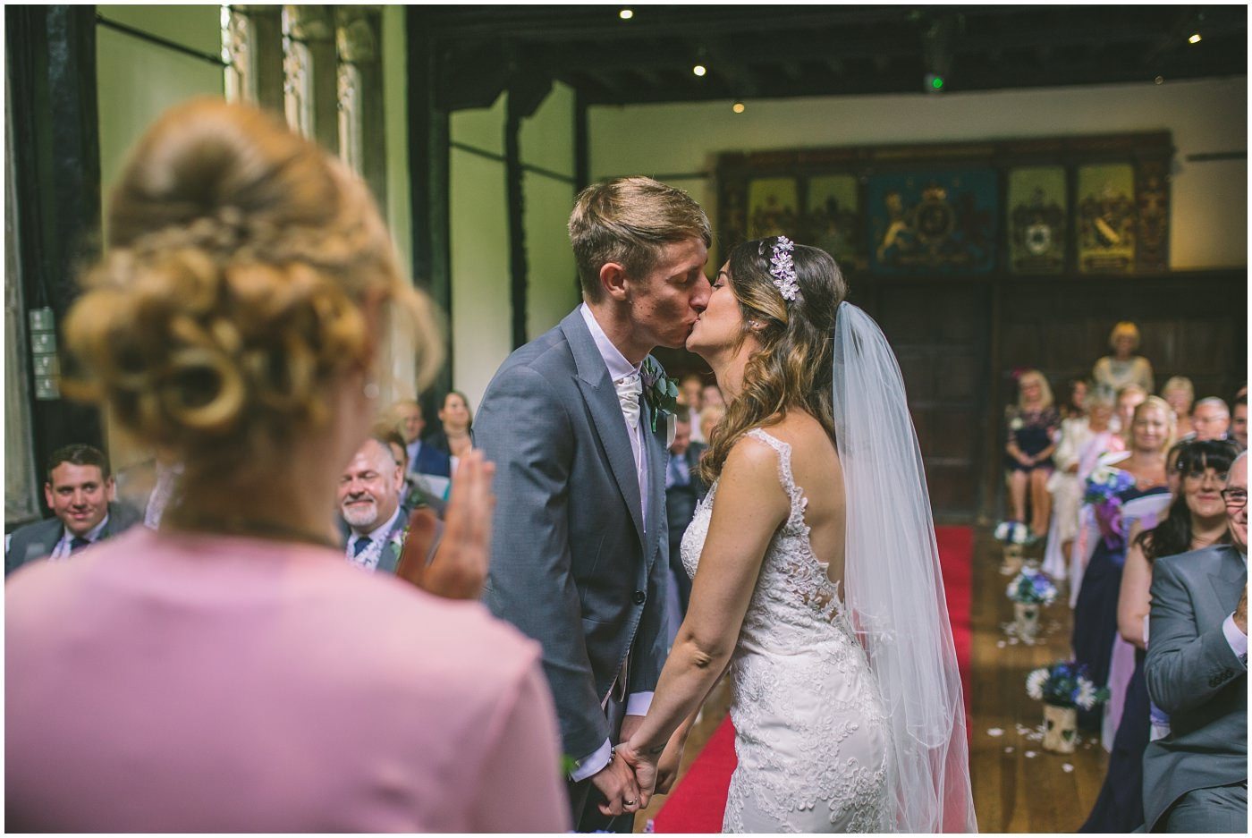 bride and grooms first kiss as they are pronounced husband and wife