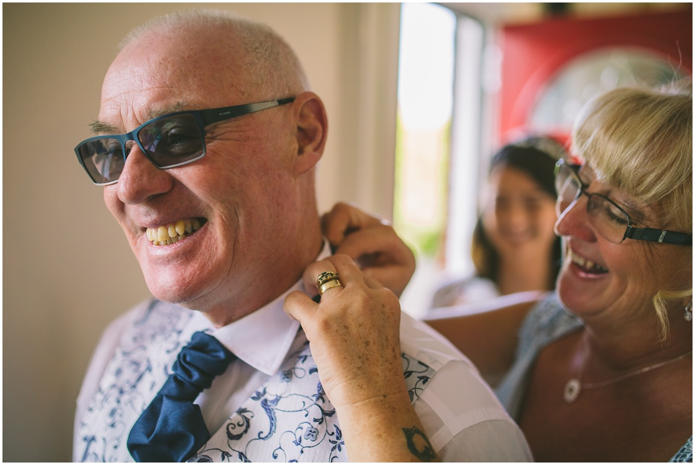 Father of the bride has his cravat fixed