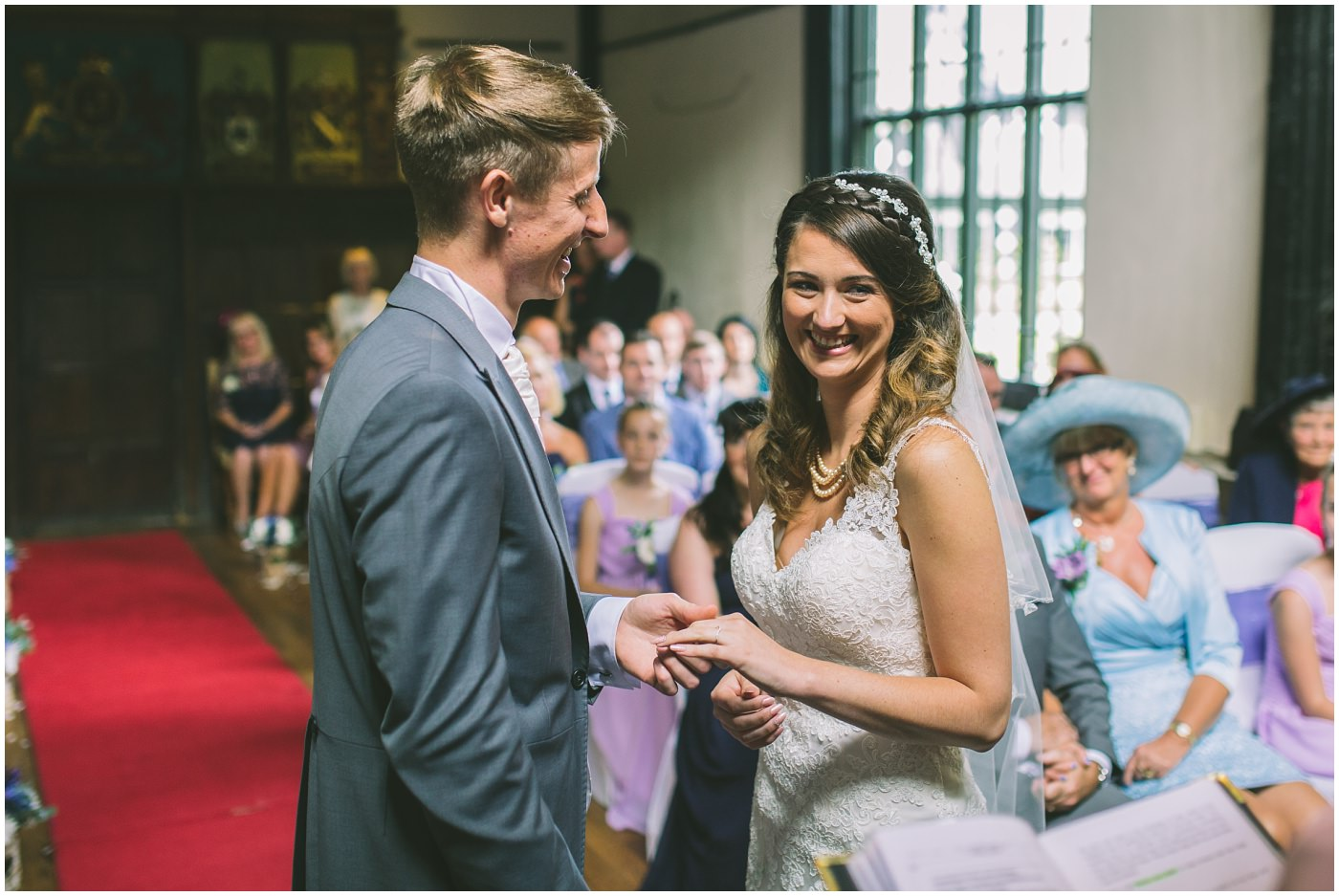 bride smiles during wedding ceremony at Samlesbury hall