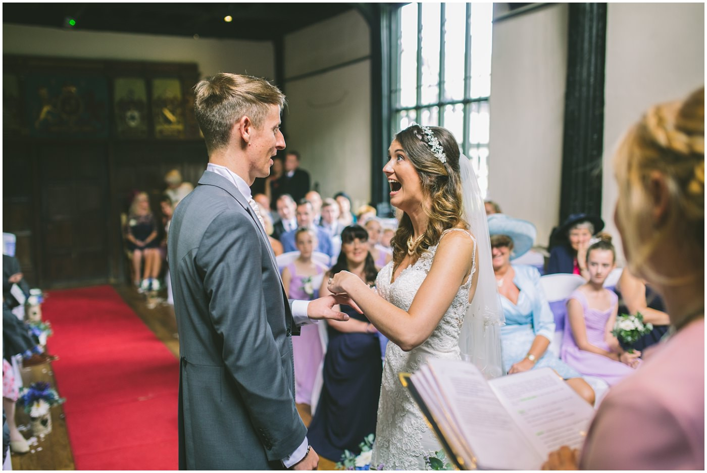 Over excited bride at Samlesbury hall as they exchange rings
