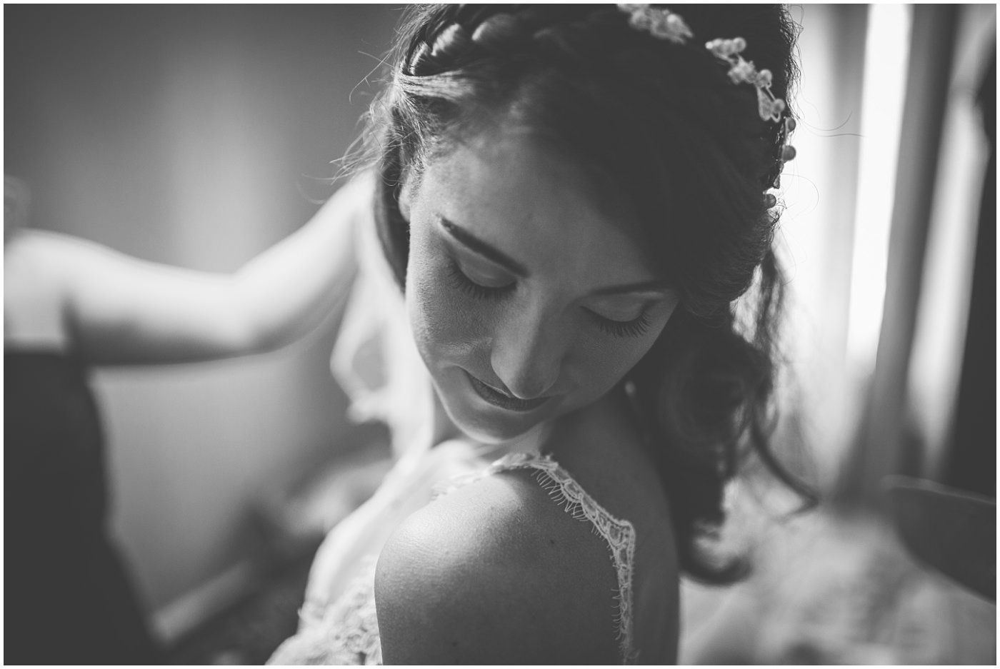 bride gets in her dress ahead of her wedding