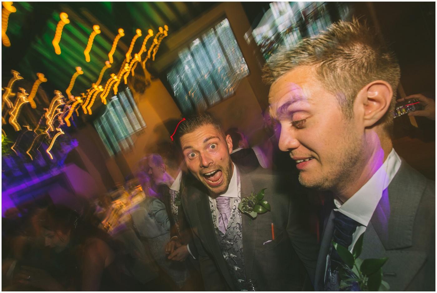 drunken groomsmen bust some moves on the dance floor