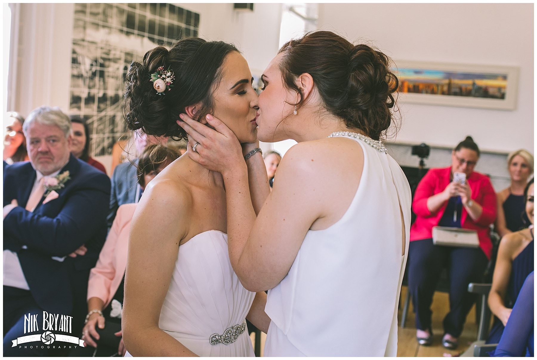 the first kiss of newly wed same sex couple