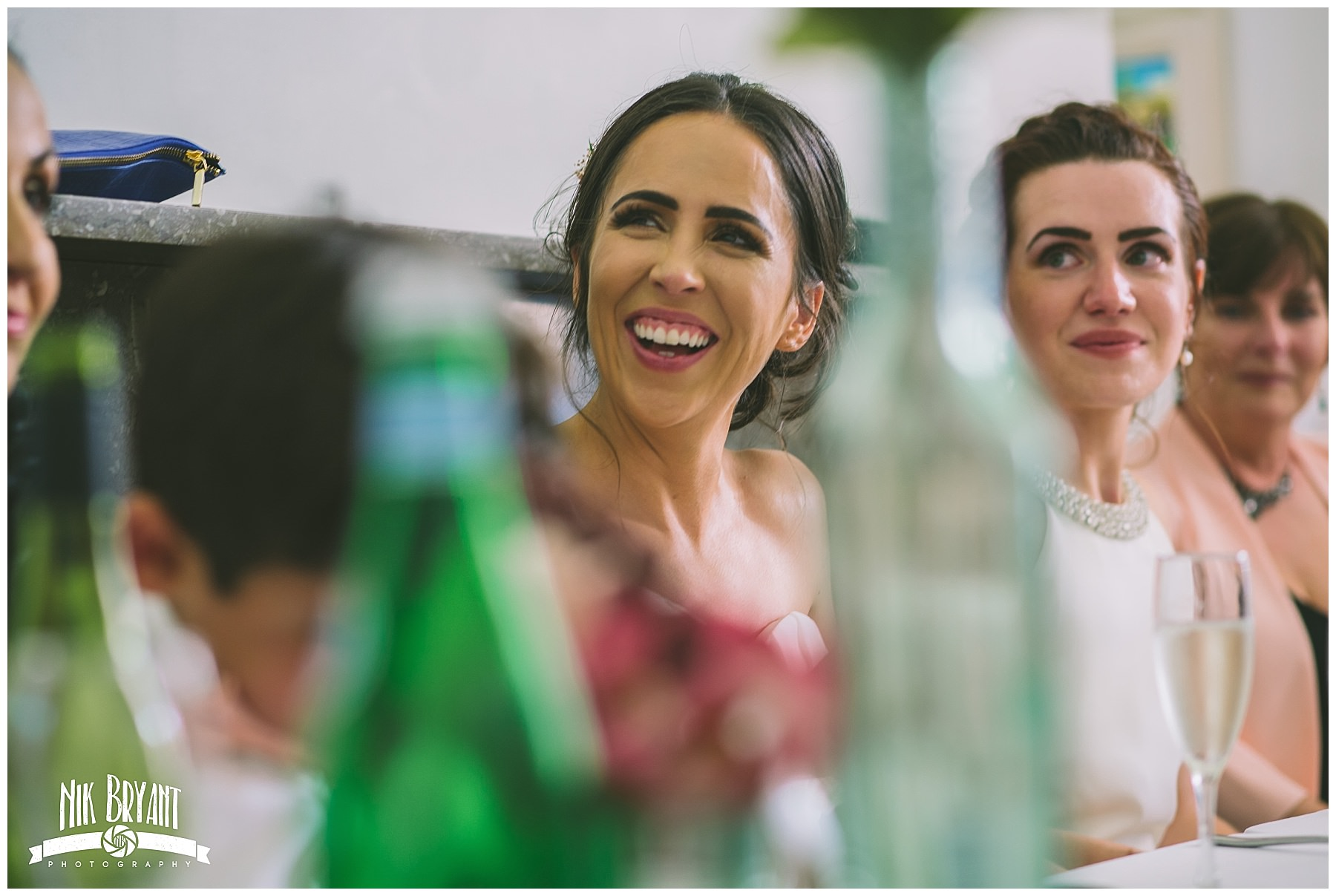 bride laughs during the speeches
