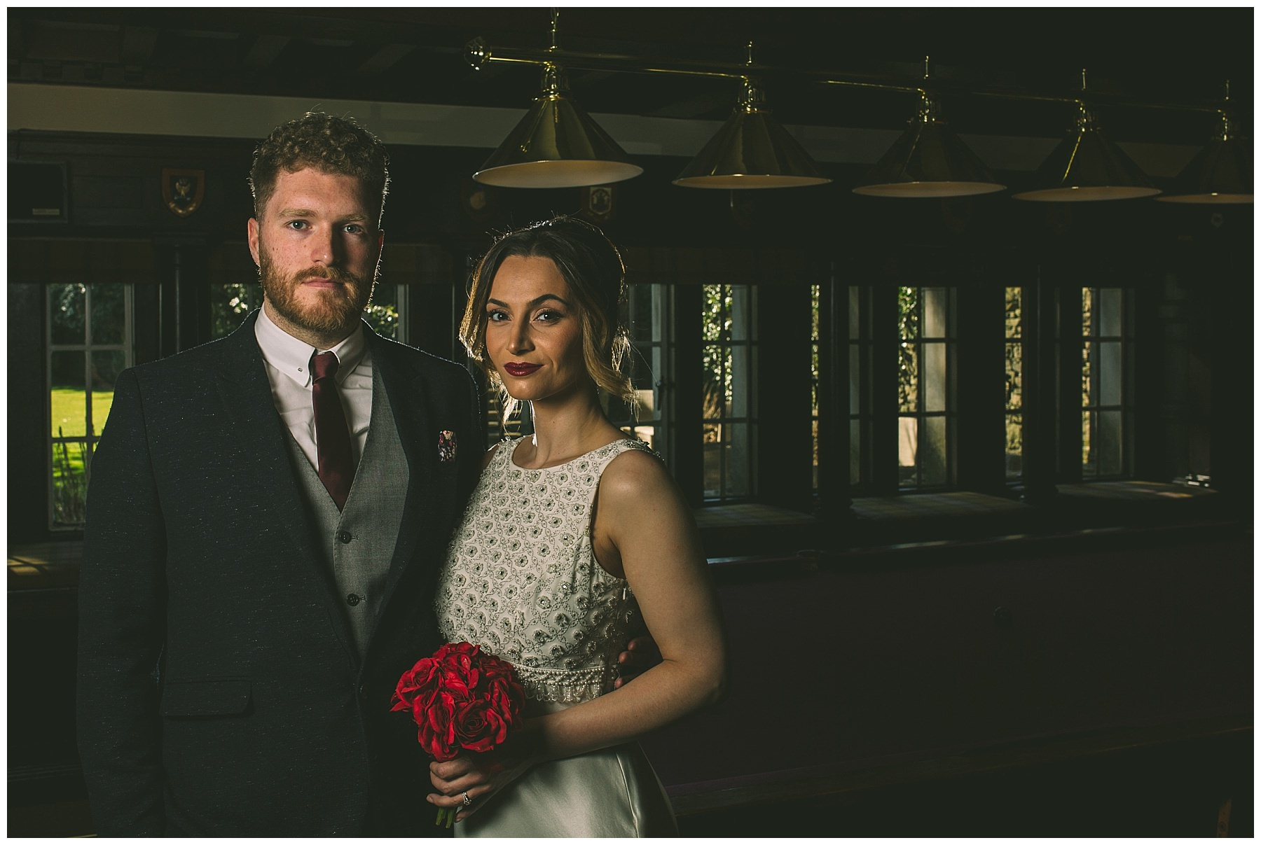 Bridal couple int the snooker room at Eaves hall