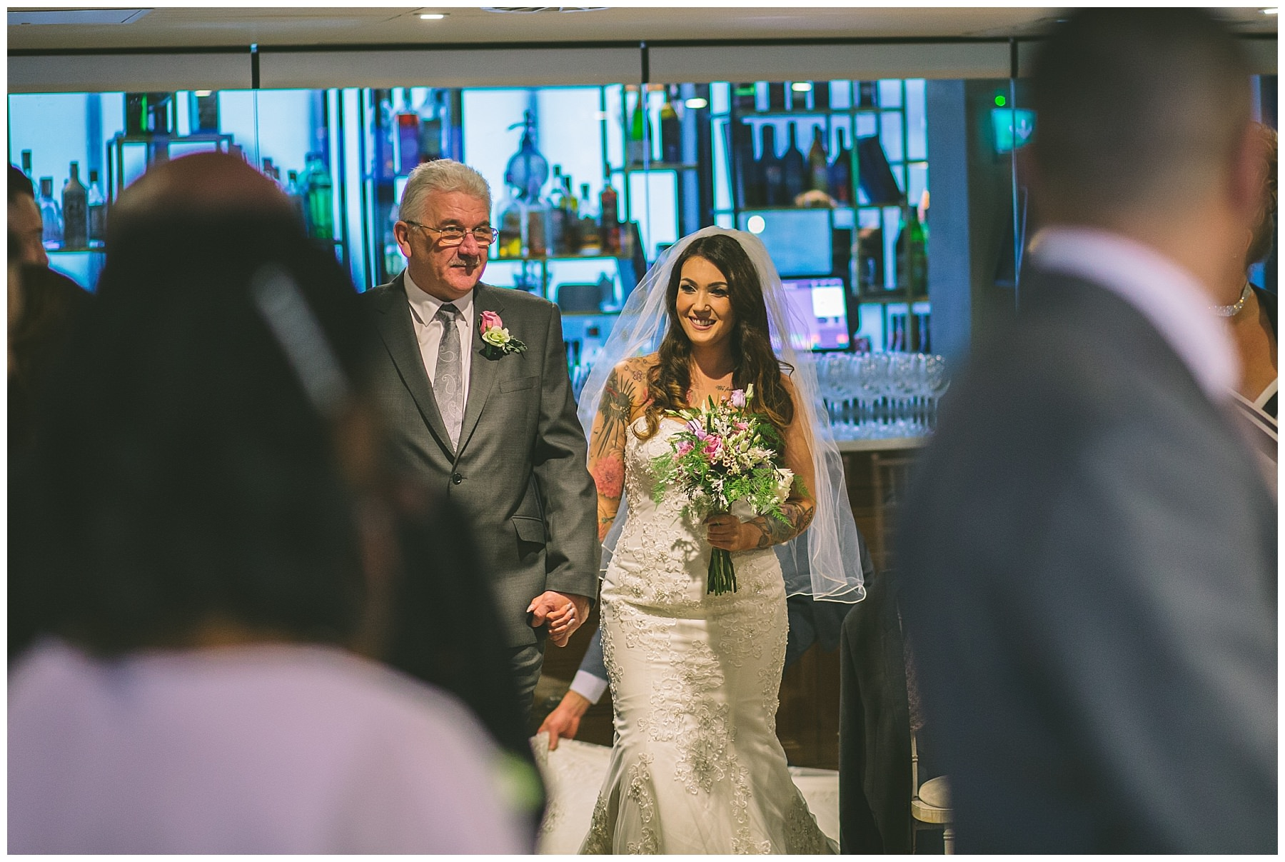 brides father walks her down the isle at king street town house