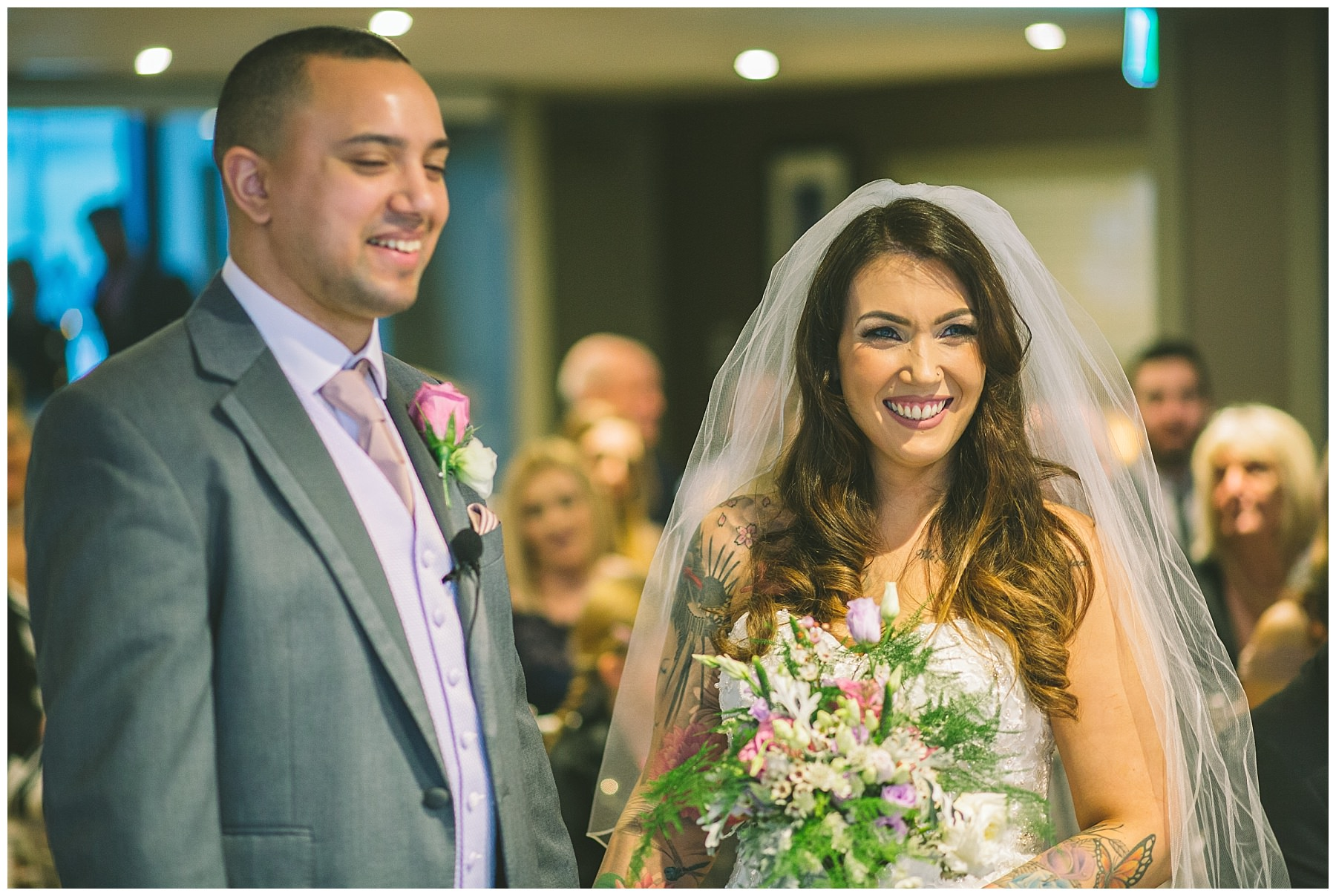 bride smiles and laughs during wedding ceremony