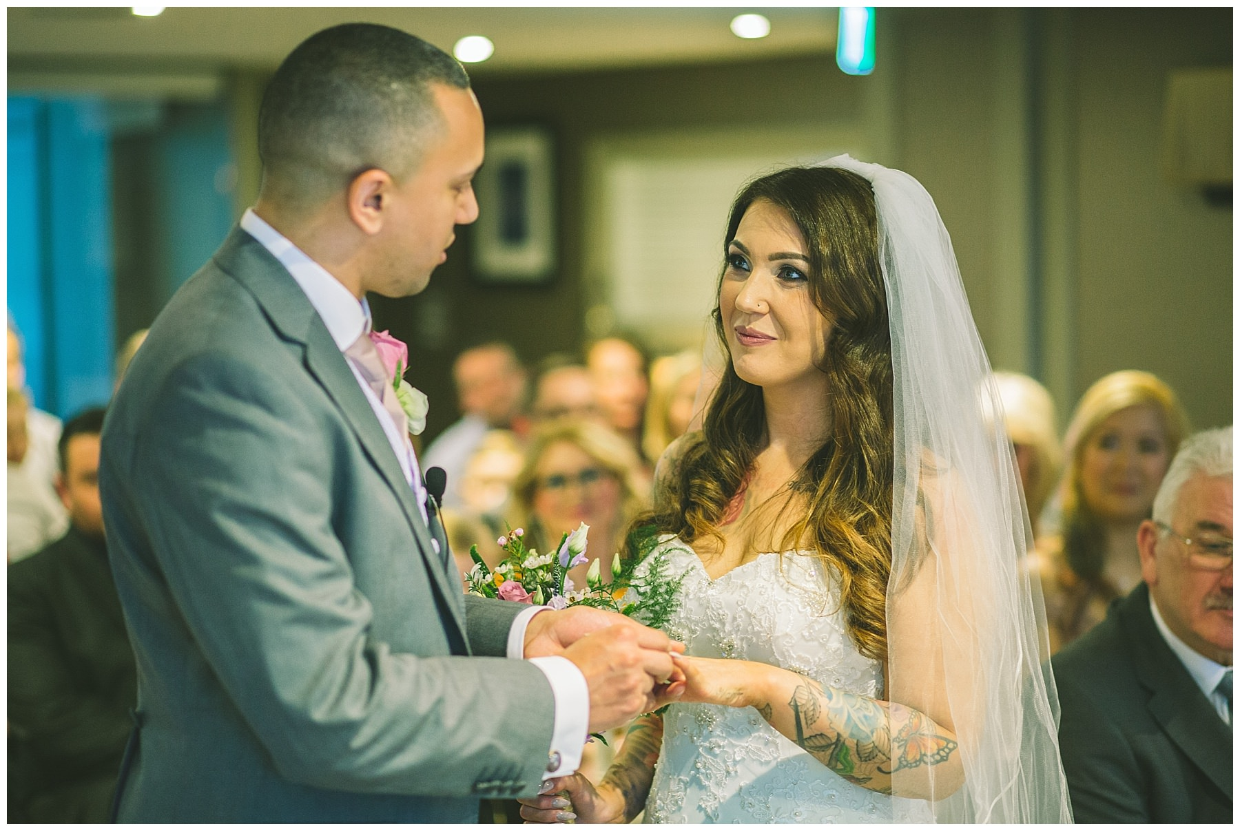 bride and groom share a moment during wedding ceremony