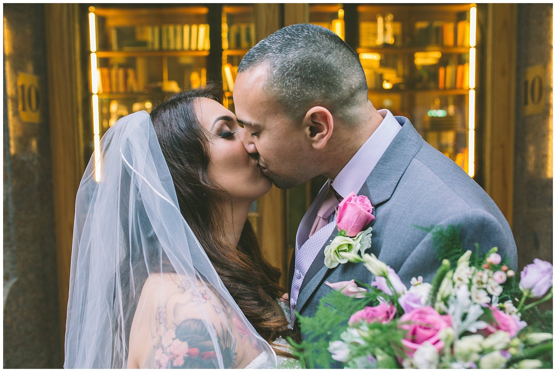 bride and groom kiss outside king street townhouse