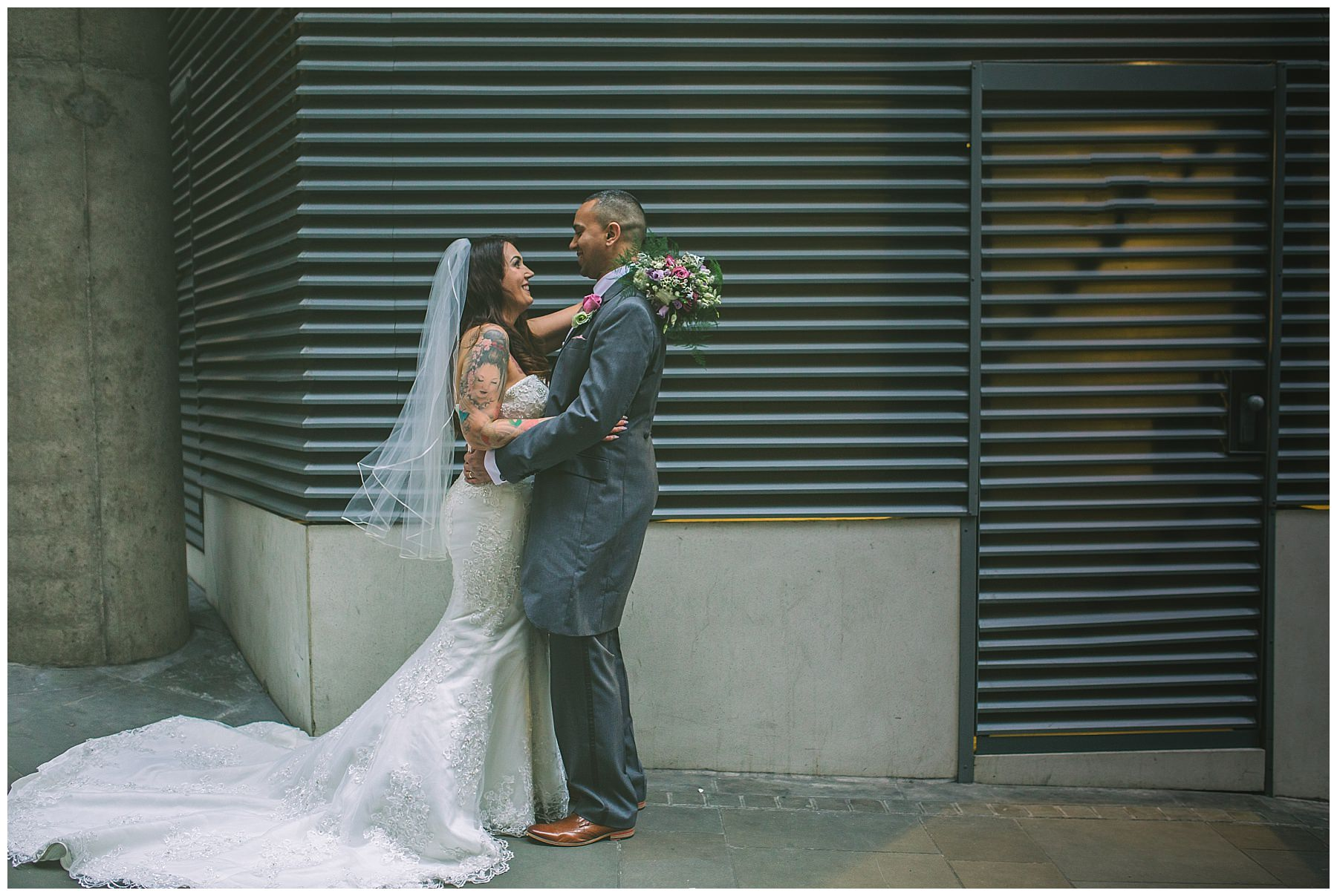 bride and groom portraits on the streets of manchester
