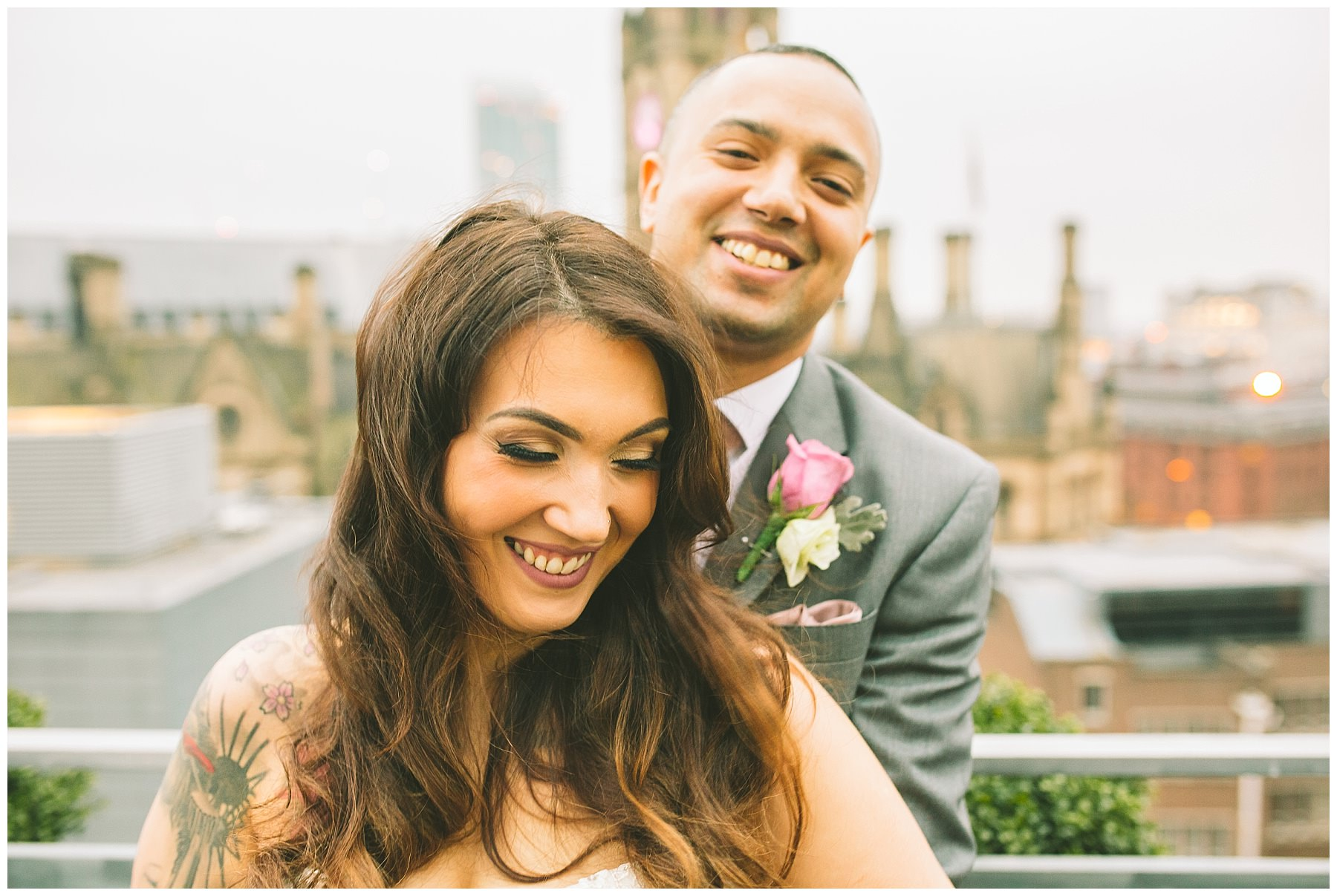 Couple share moment during winter wedding on the roof of King Street Town House
