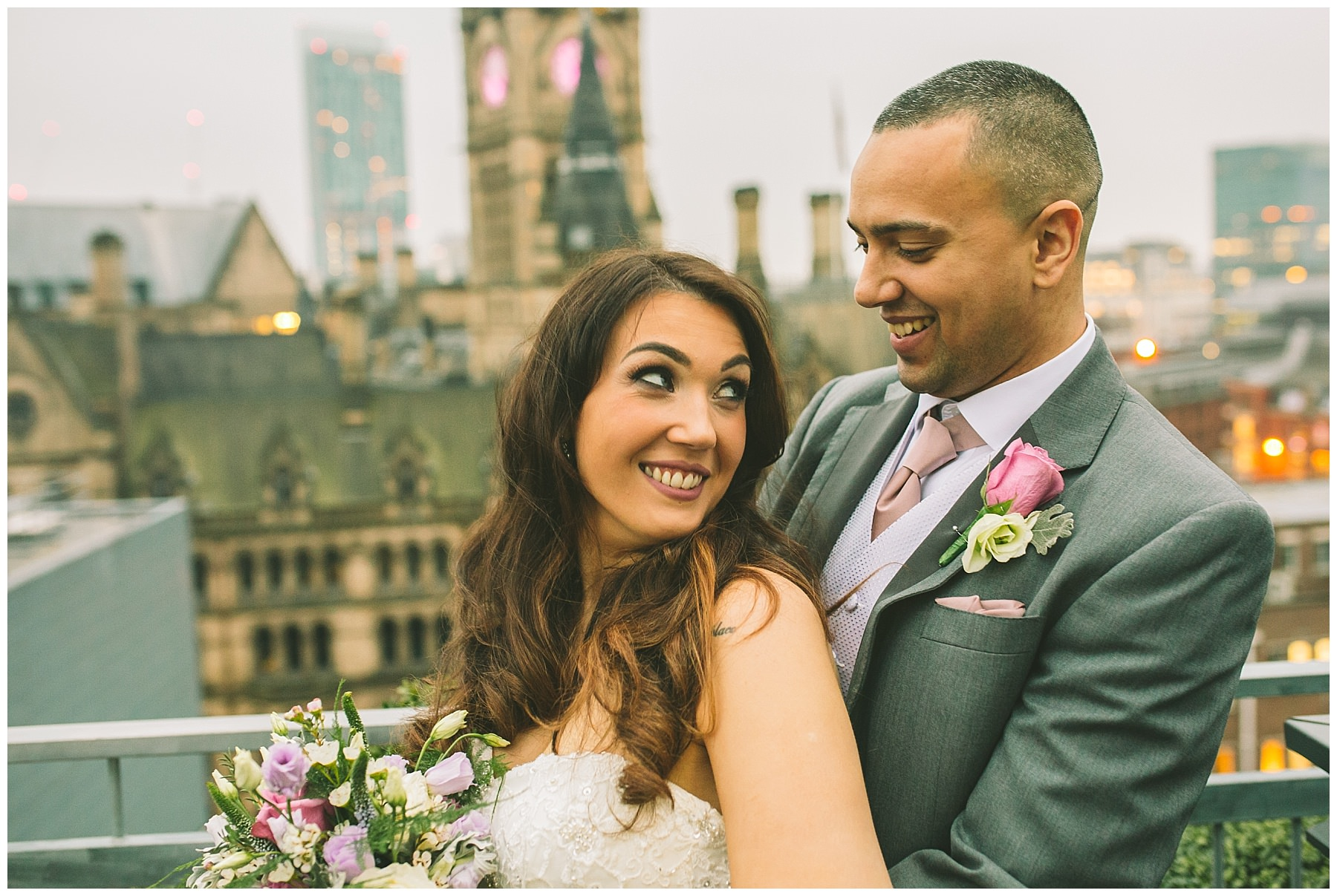 married couple stand on the roof of king street townhouse