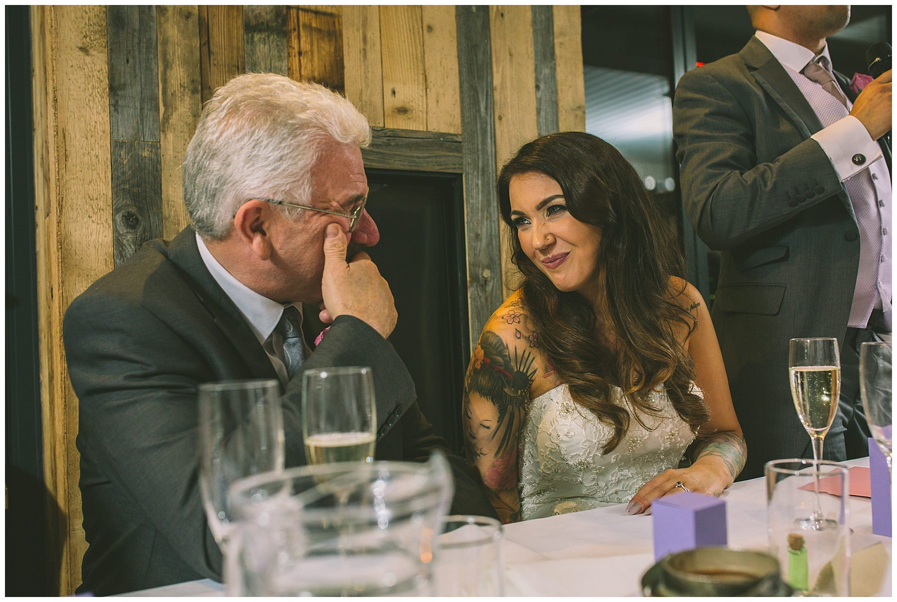 Bride and father share a moment during speeches