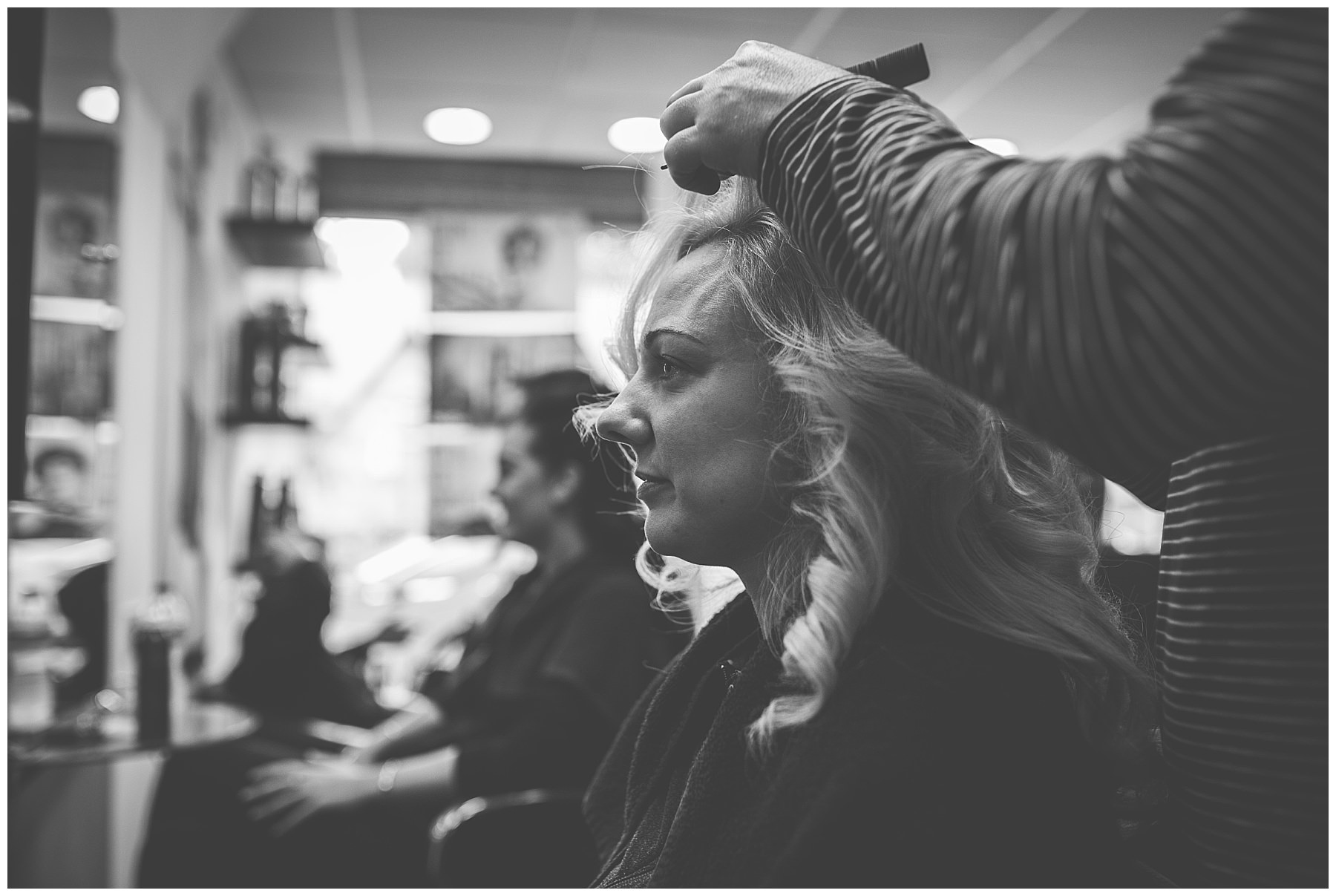 Bride has her hair done in a salon
