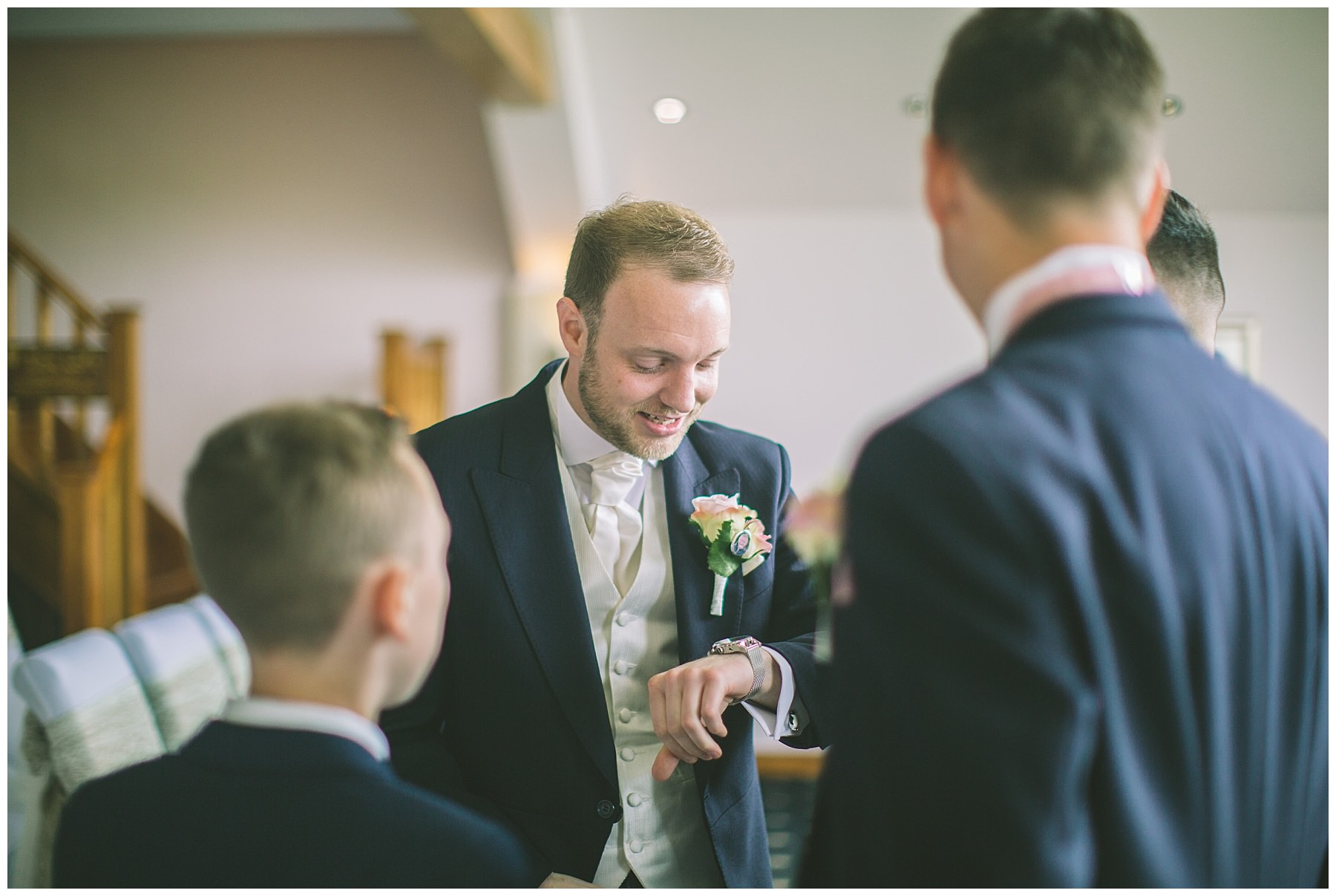 Groom checks his watch at Ramsbottom wedding