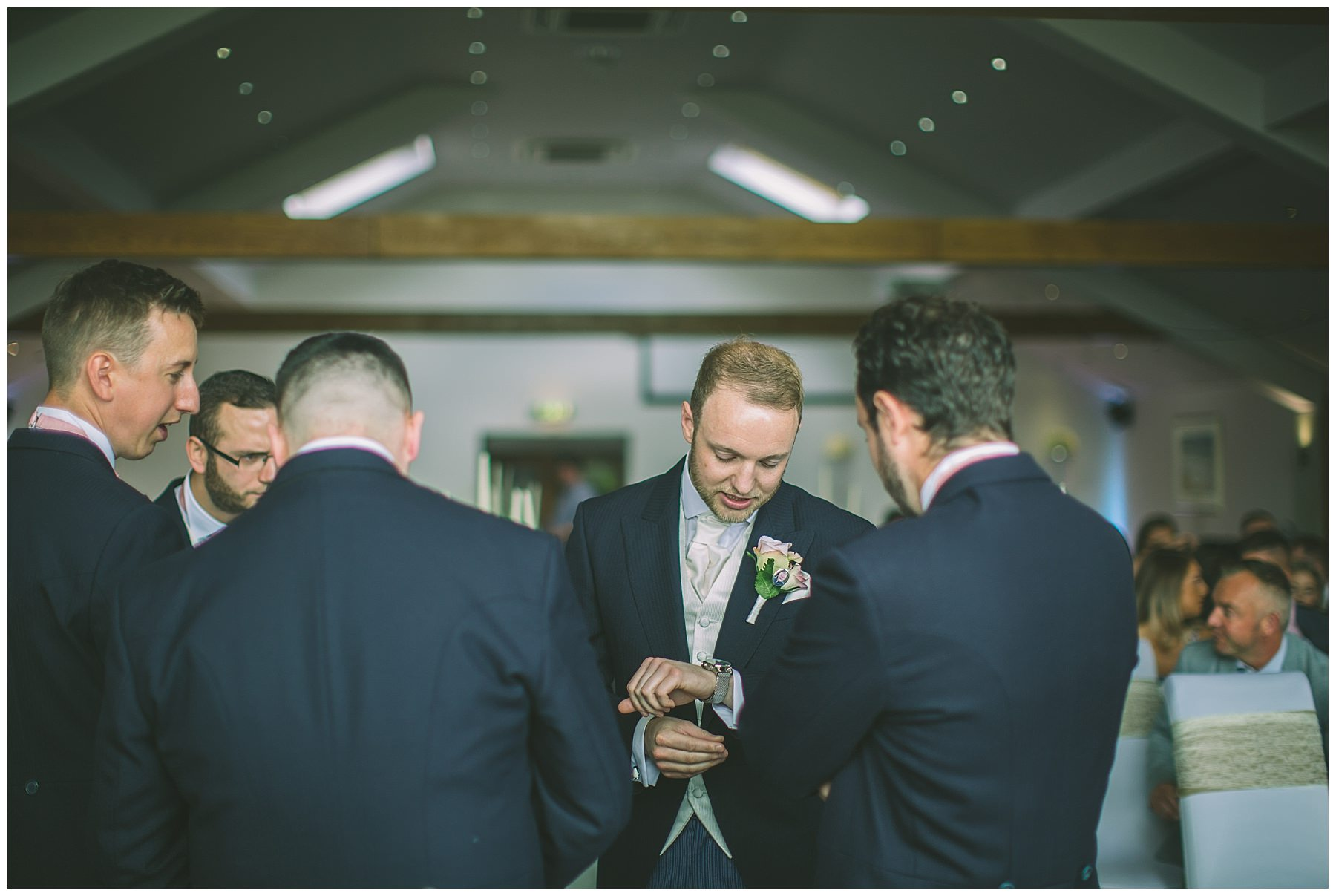 Groom checks his watch as he waits for his bride at The Fishermans Retreat