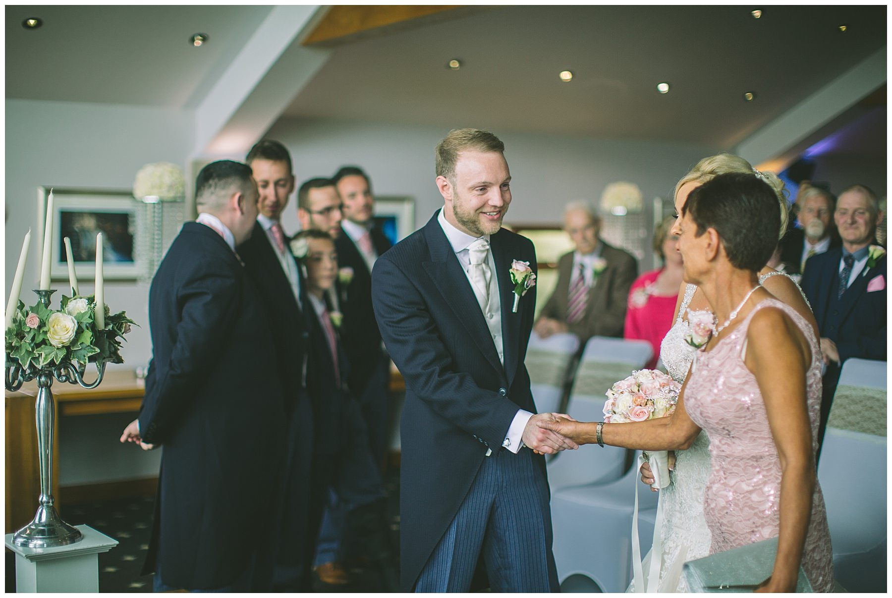 Groom Shakes hands with mother of the bride