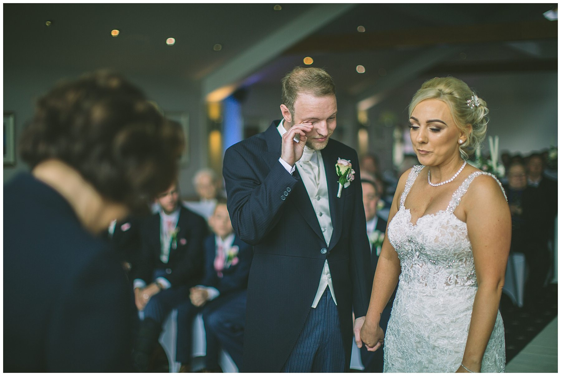 Groom wipes a tear from his eye during ramsbottom wedding