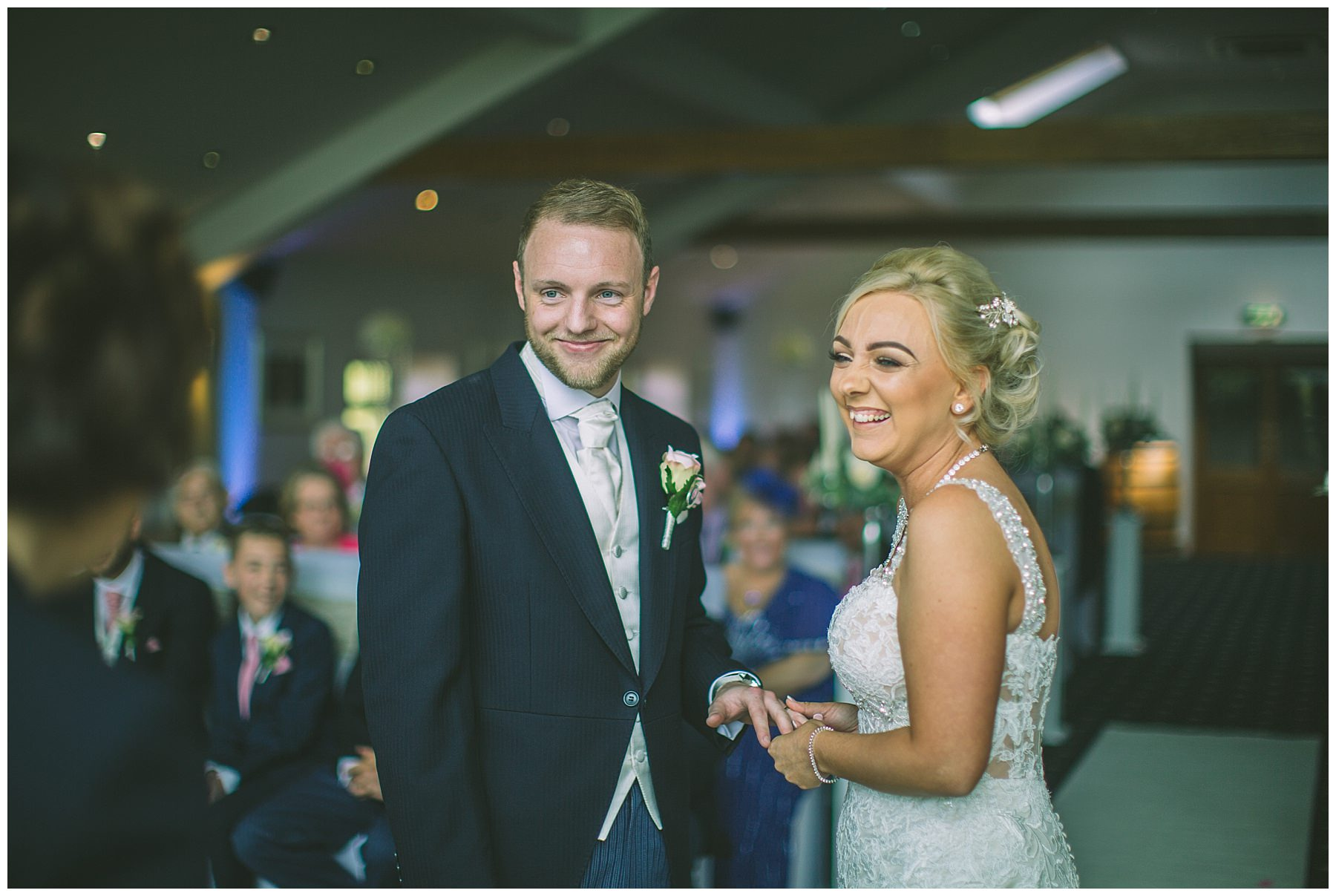 Bride and Groom smile during wedding ceremony in Ramsbottom