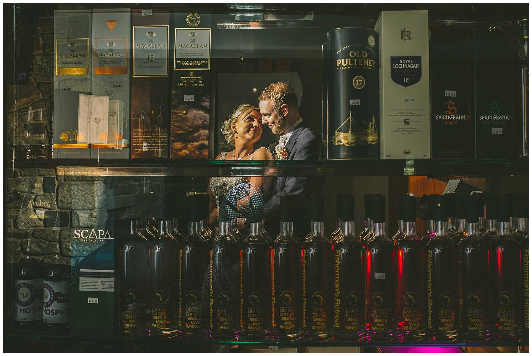 Creative portrait of the bride and groom in the whiskey room