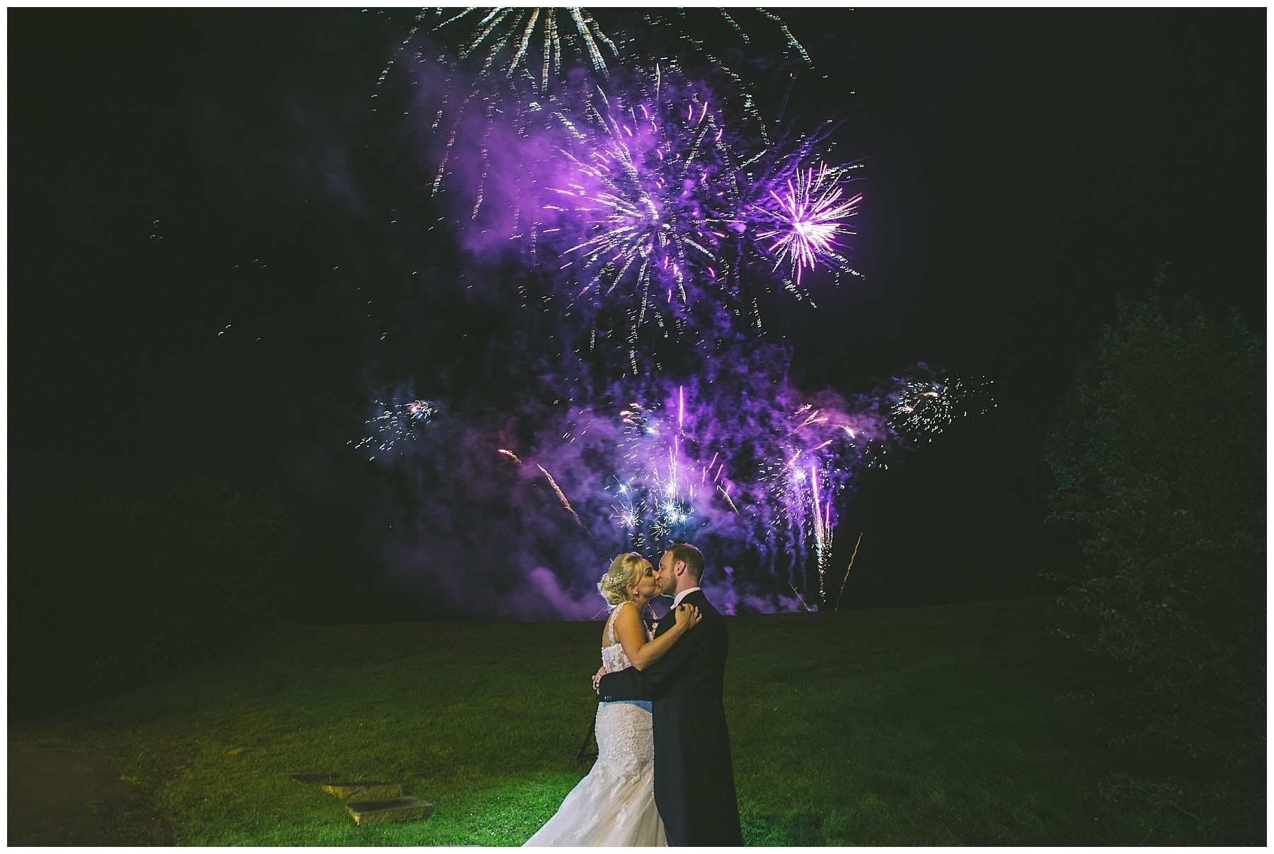 Bride and Groom kiss amongst the fireworks