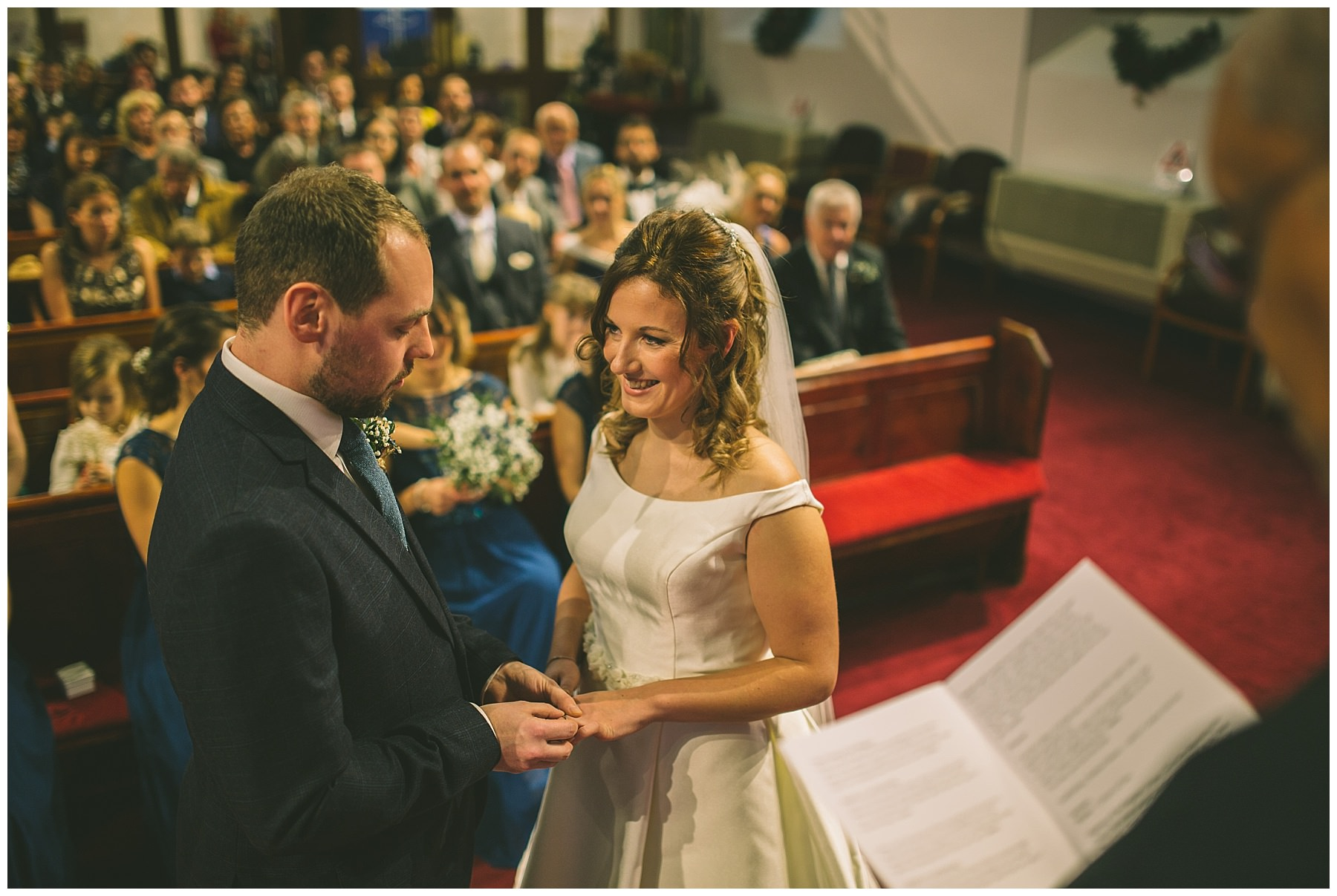 Bride and Groom exchange rings during church ceremony