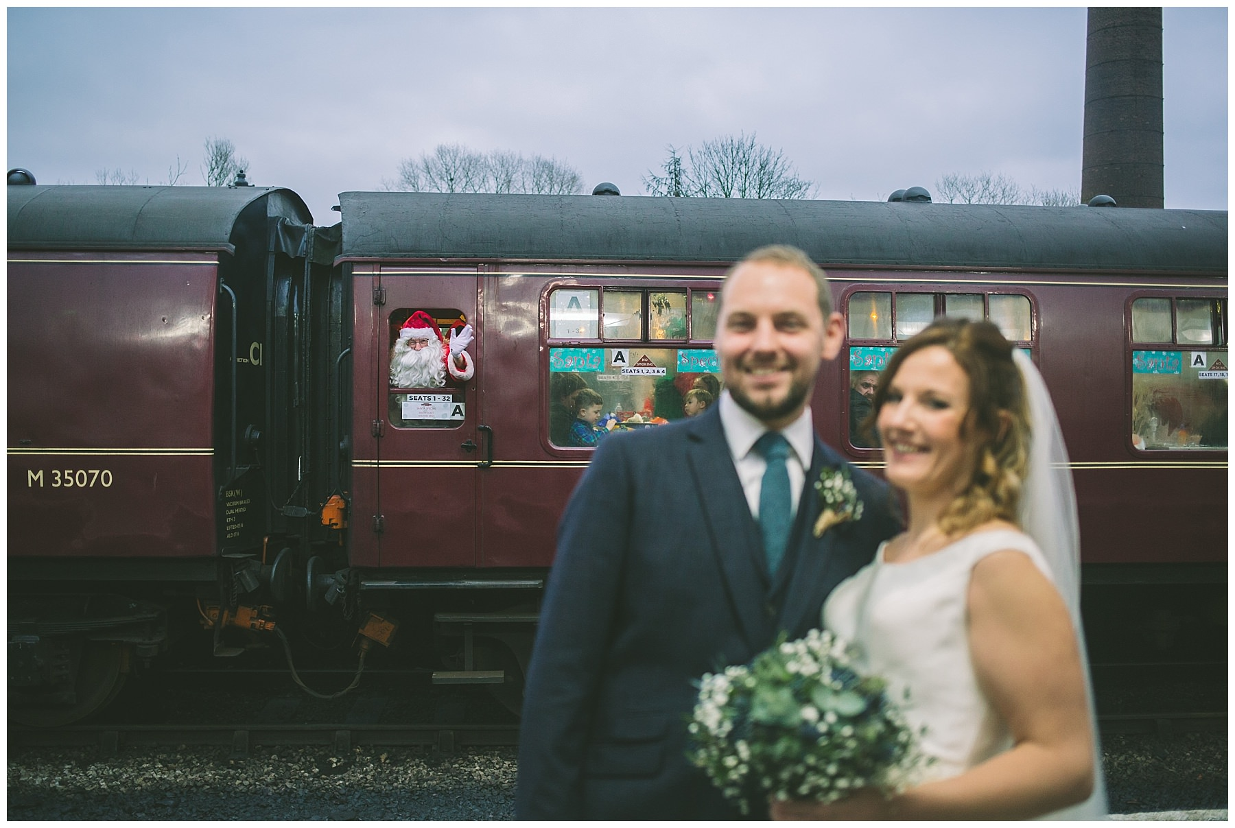 father Christmas photobombs newly married couple