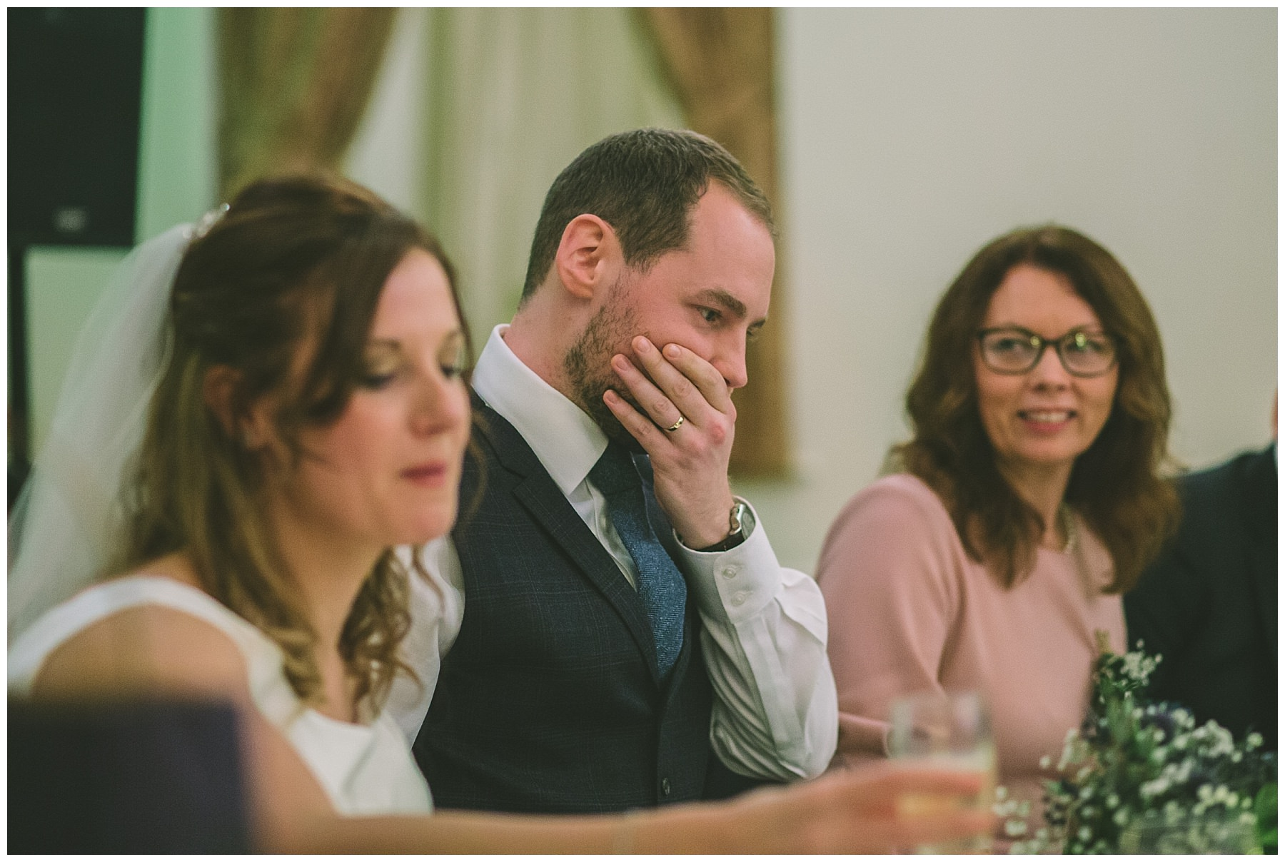 Groom reacts to speeches at ramsbottom wedding