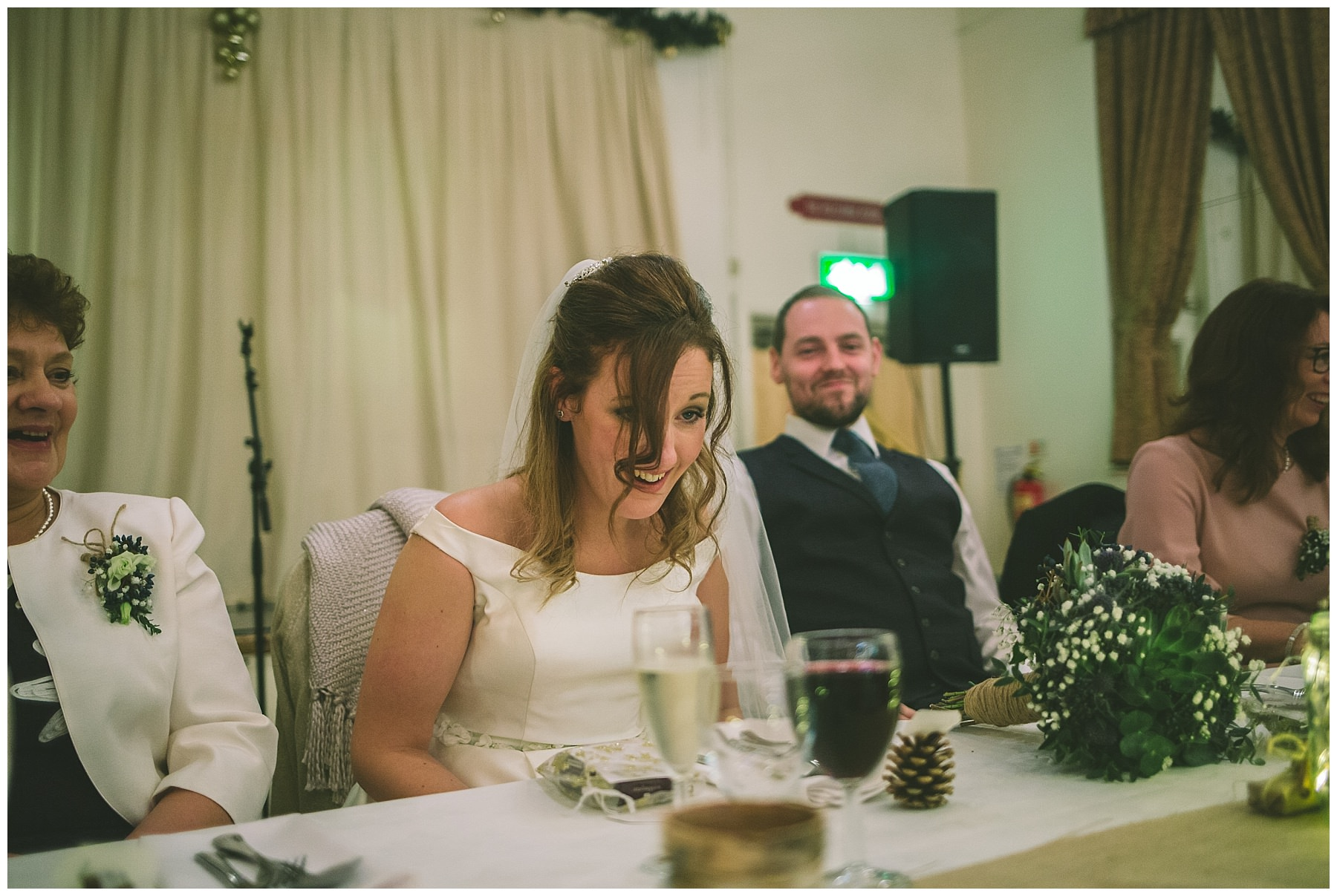 Bride reacts to speeches at ramsbottom wedding
