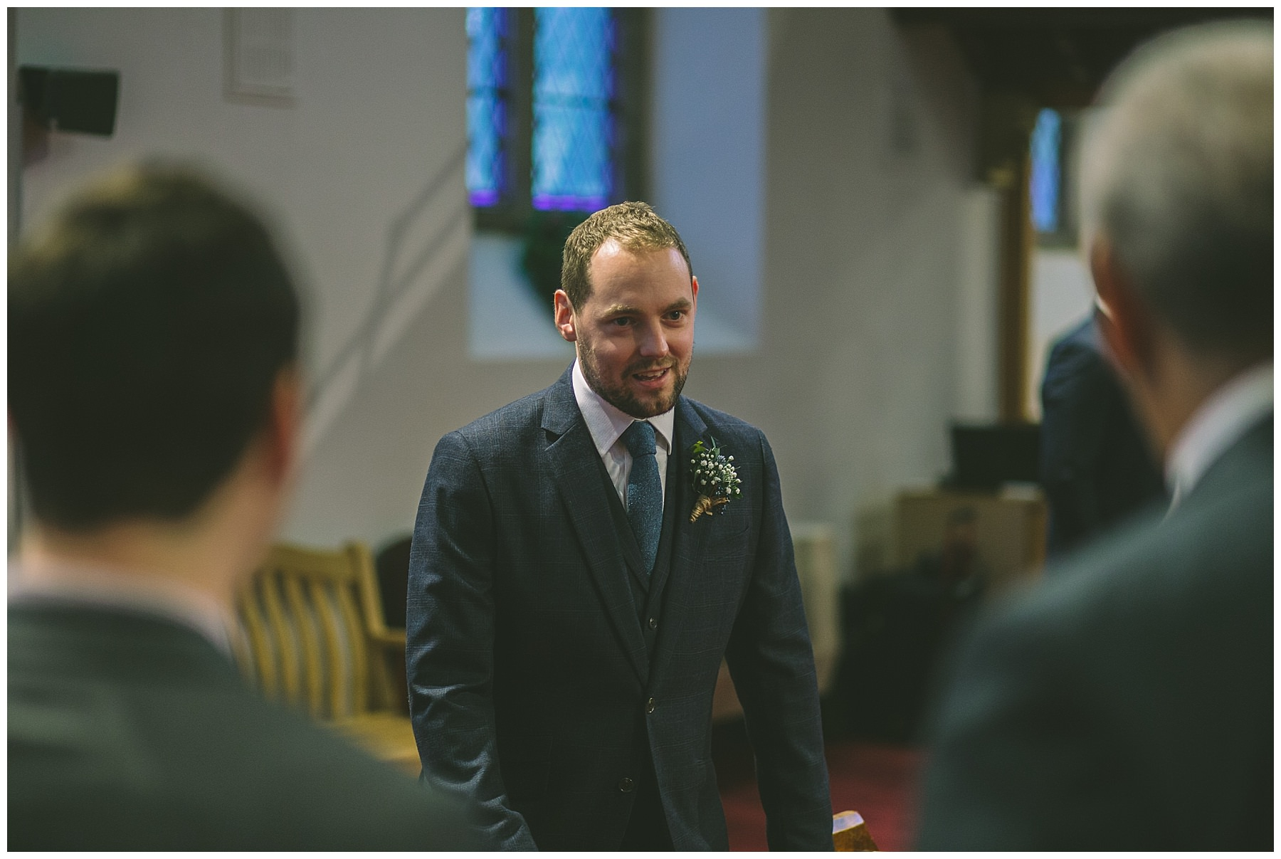 Groom waits for his bride in church