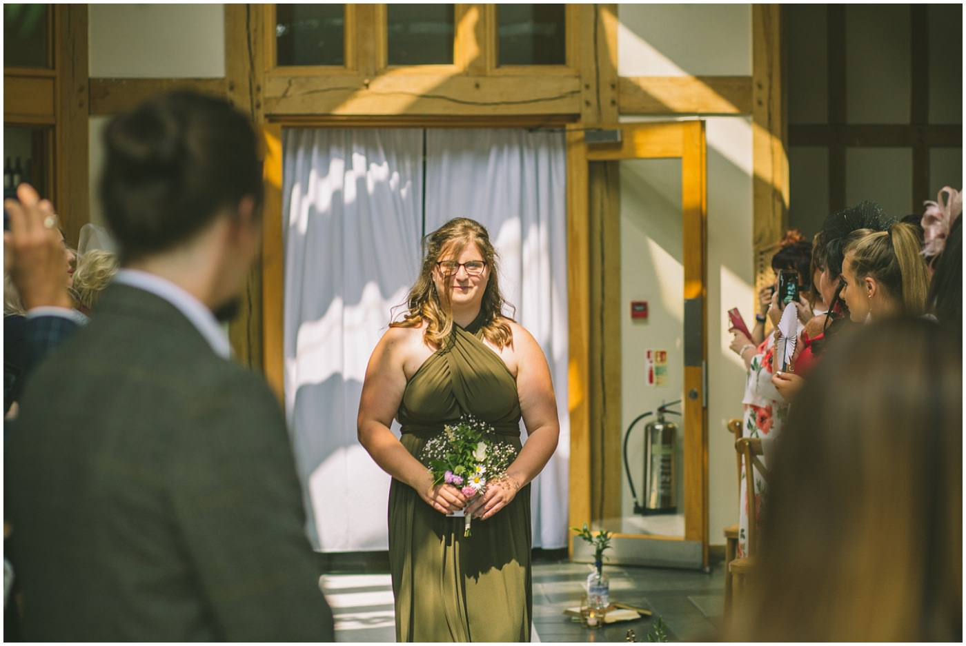 bridesmaid enters at the oak tree