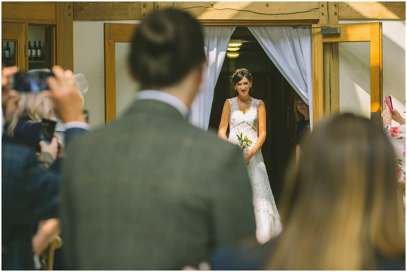 bride makes her entrance at the oaktree of peover