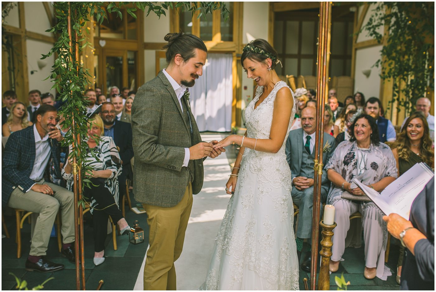 Groom exchanges rings with his bride during knutsford wedding