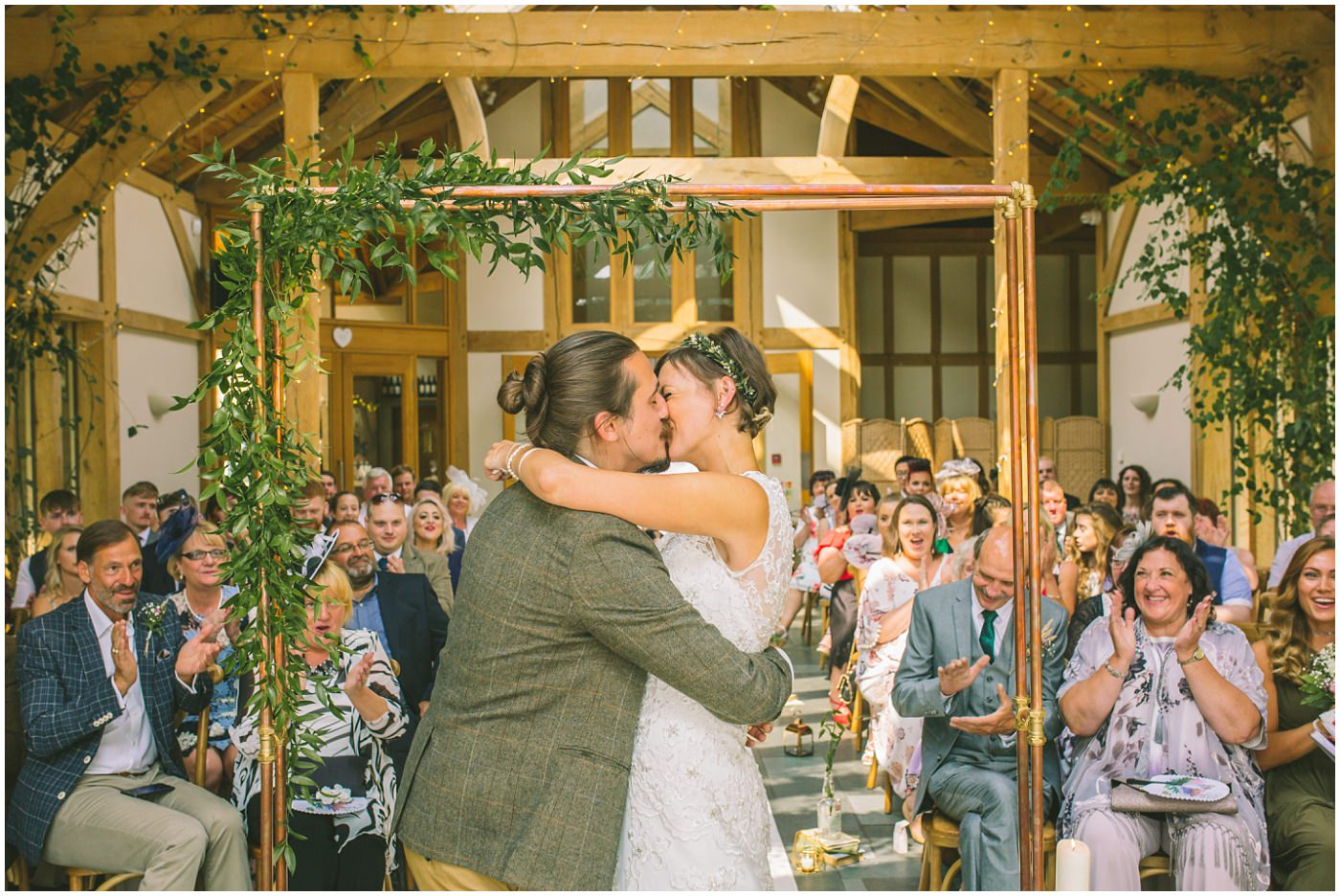 Bride and Groom kiss in wedding ceremony in knutsford