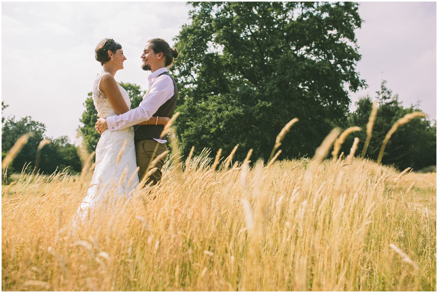 bridal portraits in golden fields of wheat