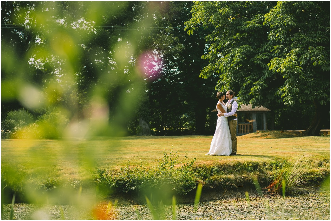Bride and Groom shot on the lawns over the lake