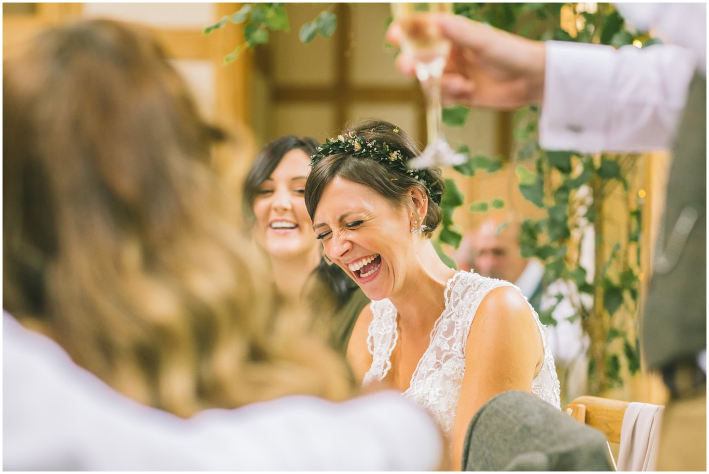 Bride laughing in reaction to speeches