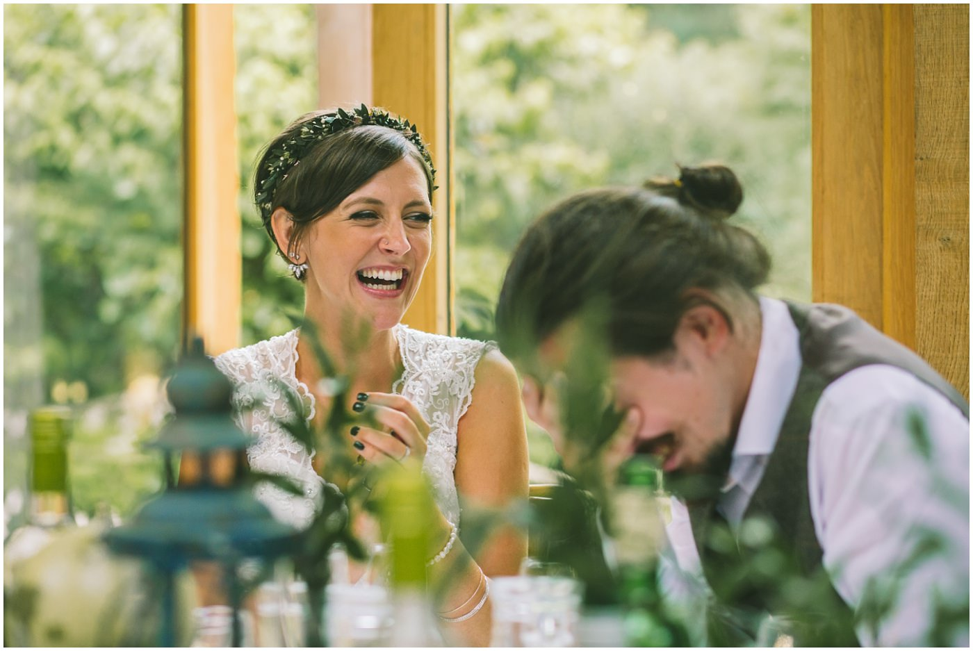 bride laughs as the groom hides his head in his hands